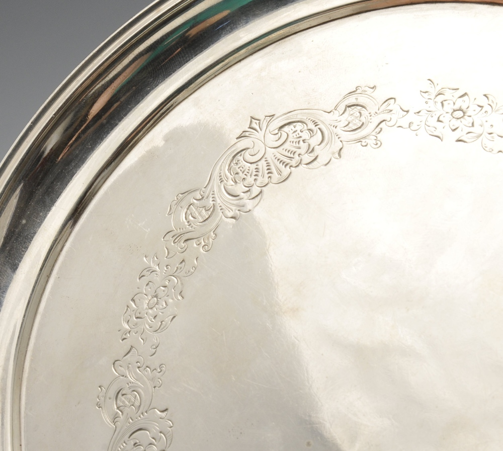 Lot 447 - A mid-eighteenth century Russian silver salver of circular form with floral border and raised