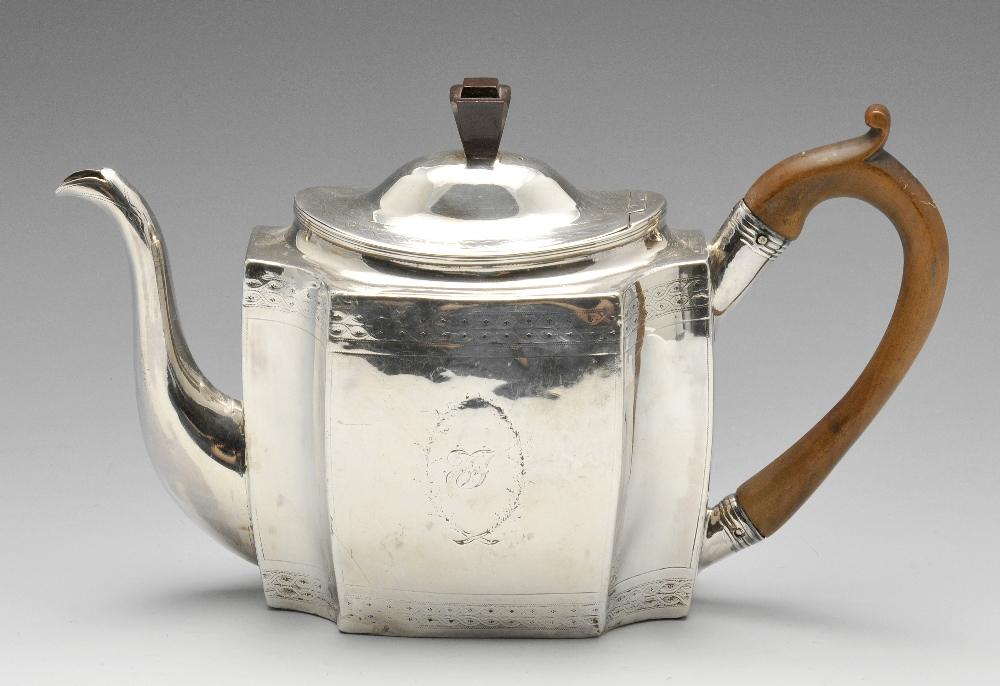 Lot 20 - A George III silver teapot, the oblong form initialled and crested with wide fluted corners and