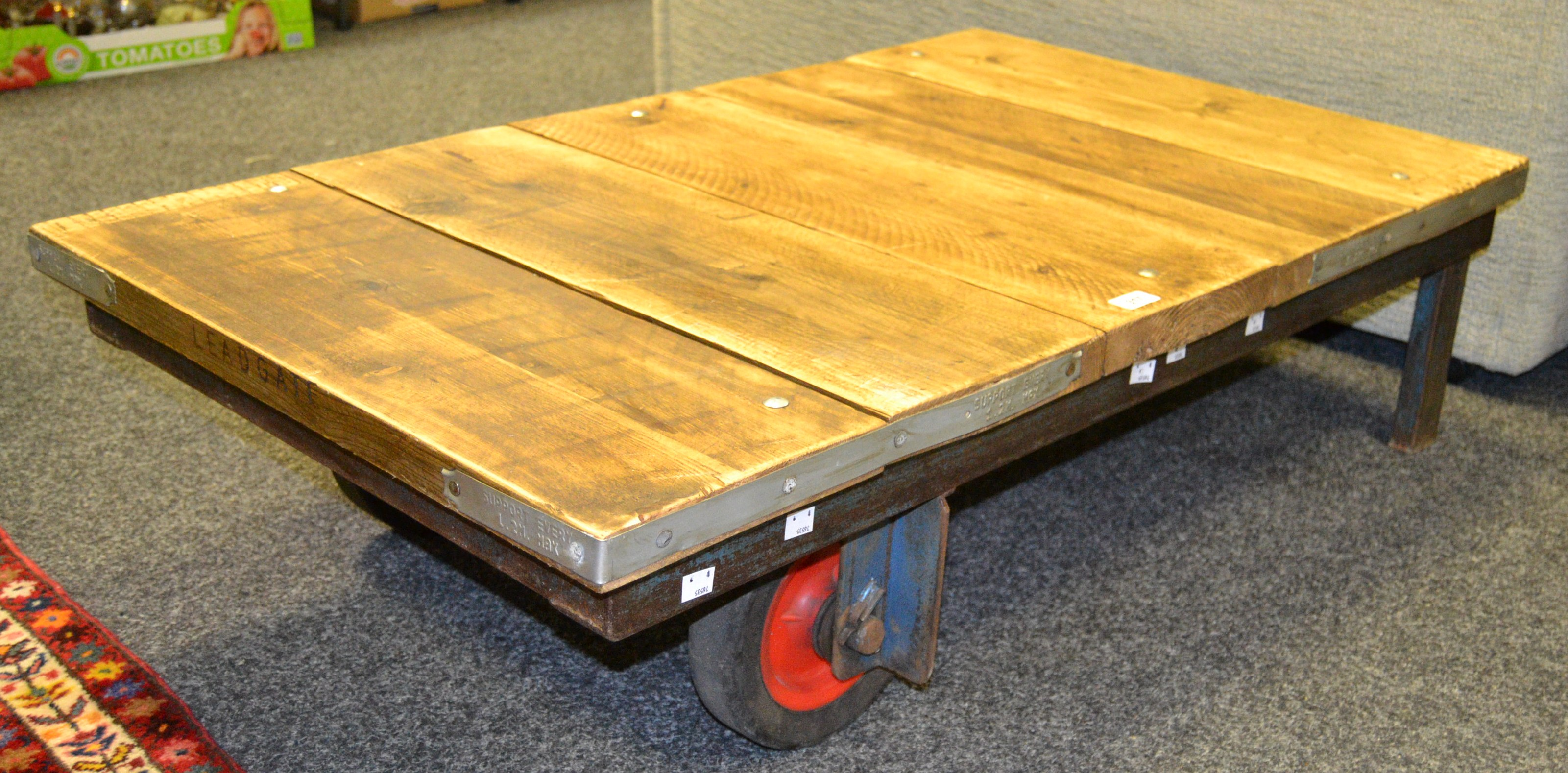 Lot 317 - Industrial Salvage - a salvaged scaffolding planked coffee table on an earlier industrial base,