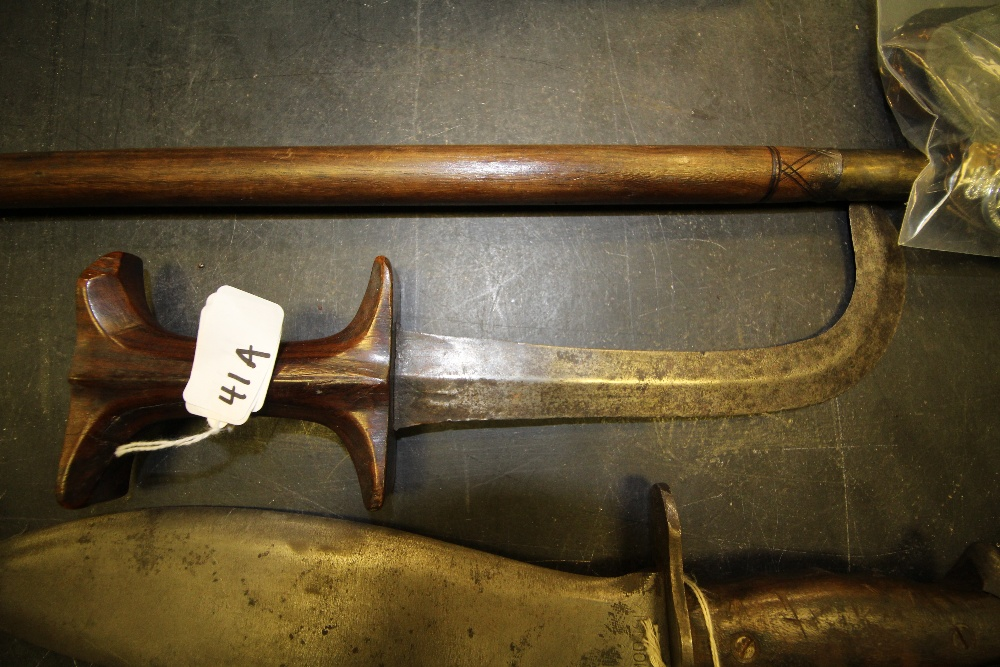 Lot 41A - A Malayan kris having 20cm curved blade and hardwood handle.