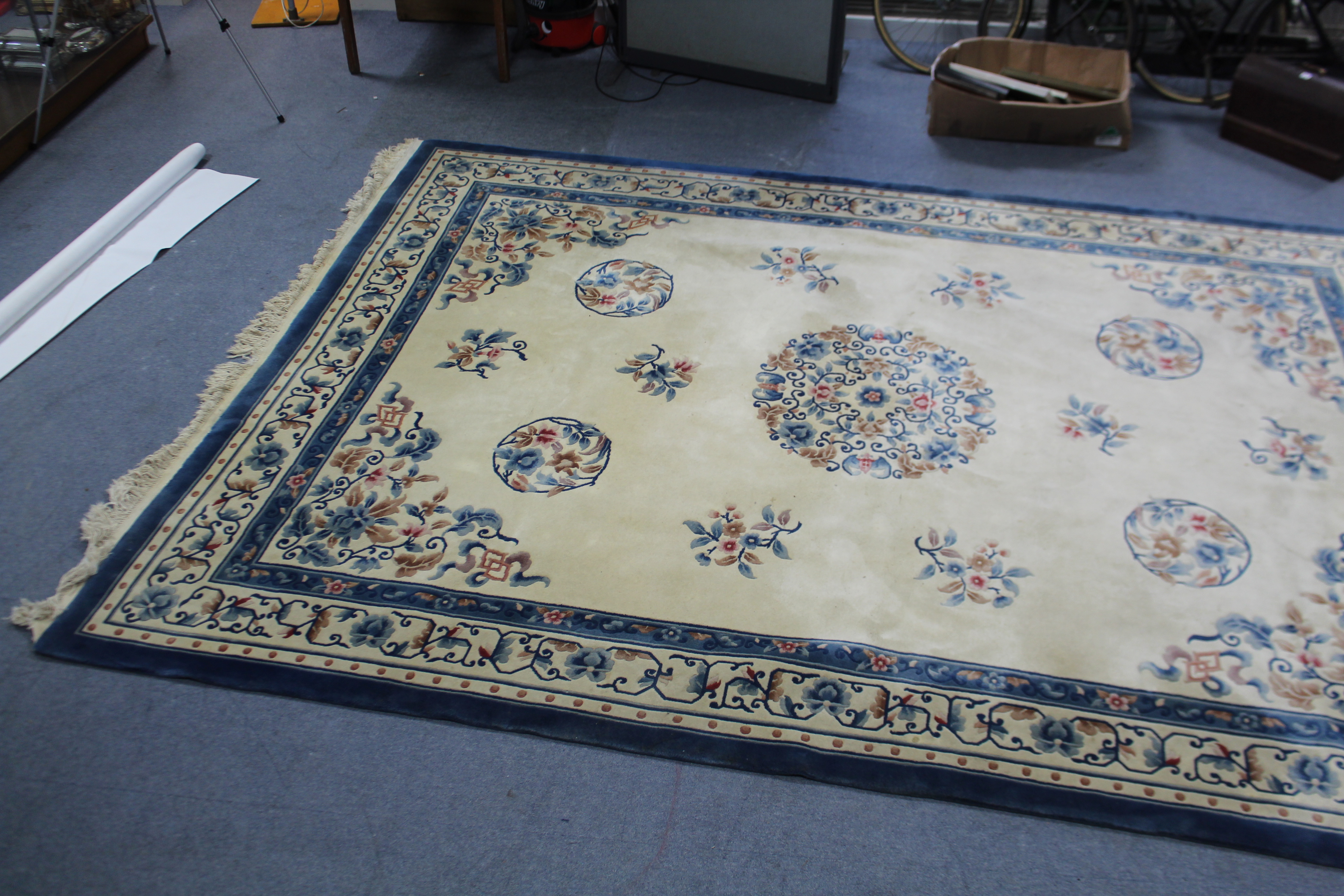 Lot 60 - A Chinese-style carpet of cream ground & with bright-coloured floral design to centre within a