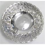 """A large silver plated circular comport with embossed fruit border, & on round pedestal foot, 19"""""""