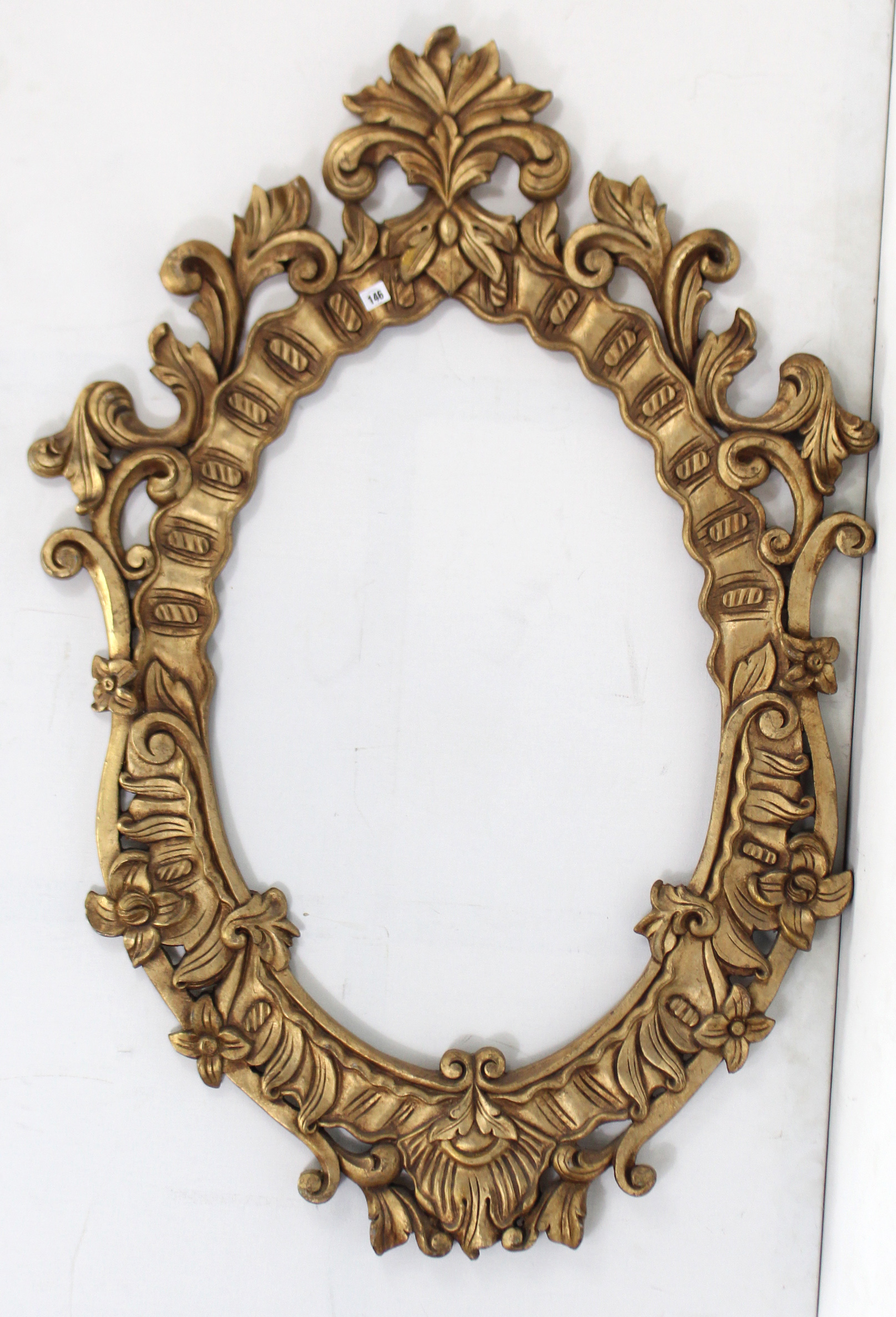 """Lot 169 - A 19th century-style gilt composition frame oval picture frame, with scroll border, 53½"""" x 40""""."""