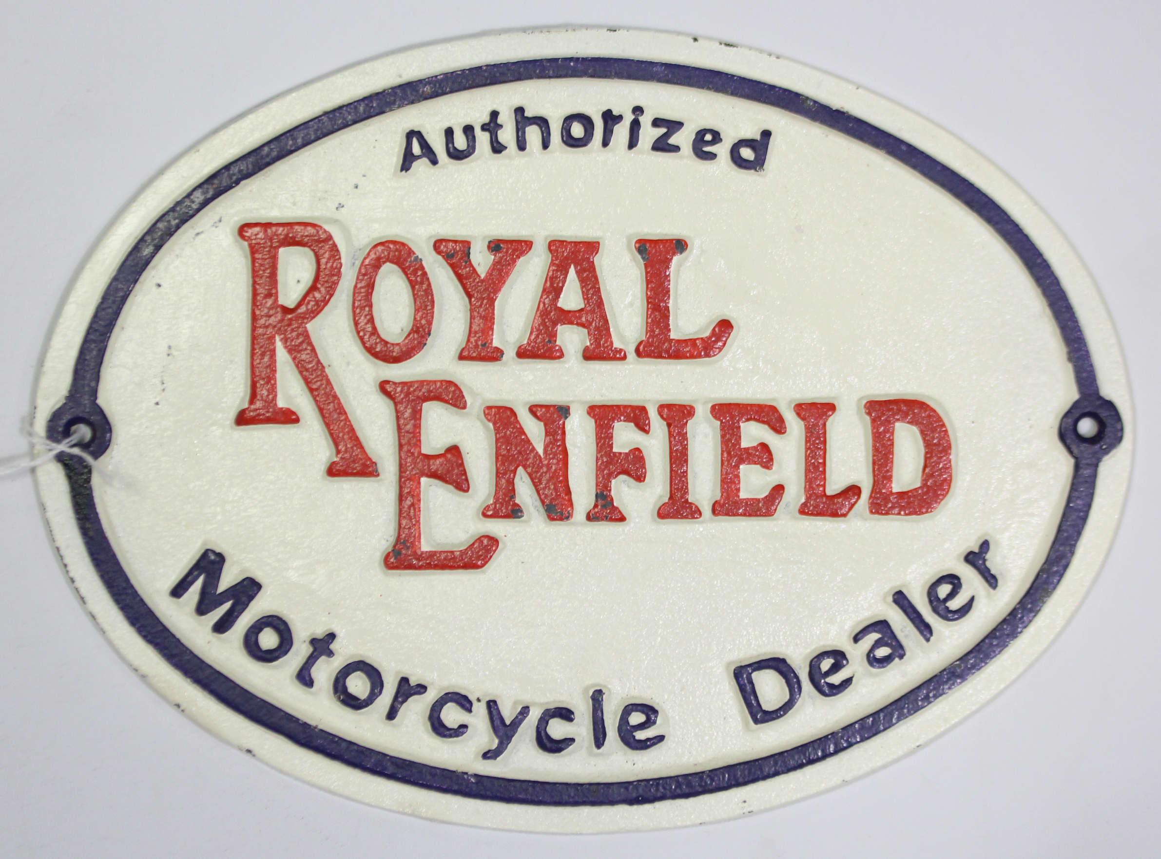 """Lot 68 - A reproduction painted cast-iron oval sign """"Authorised ROYAL ENFIELD Motorcycle Dealer"""", 8"""" x 11""""."""