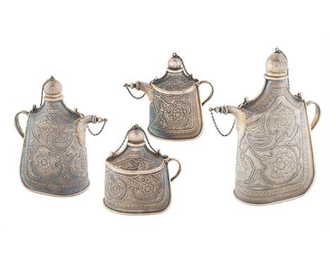 AN EXCEPTIONAL SET OF FOUR RUSSIAN SILVER TROMPE L'OEIL PILGRIM FLASKS FOR TIFFANY & CO., NEMIROV-KOLODKIN, MOSCOW, 1899-