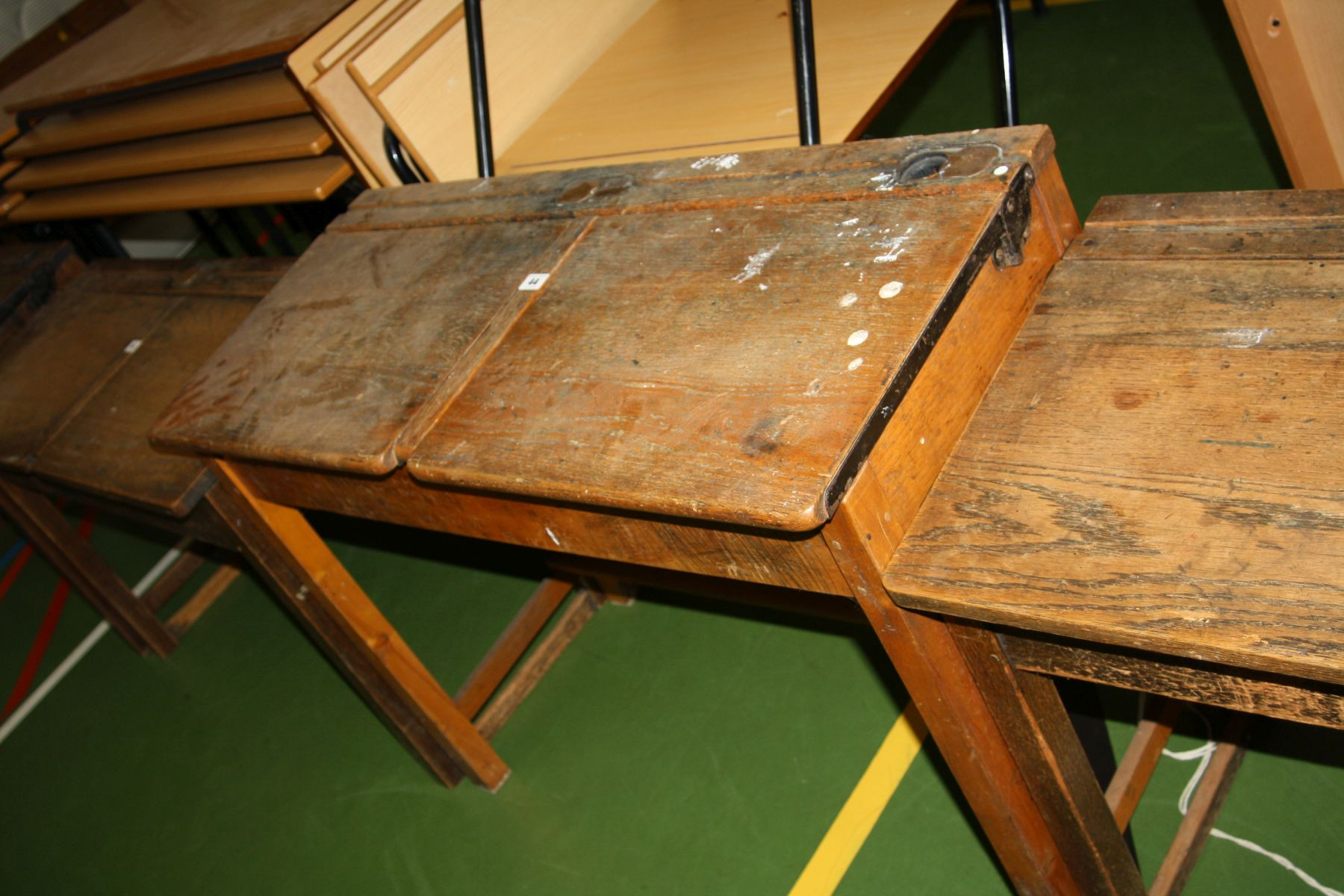 Lot 44 - A VINTAGE DOUBLE SCHOOL DESK, with oak top, two lift up lids, two copper sliding ink well cover