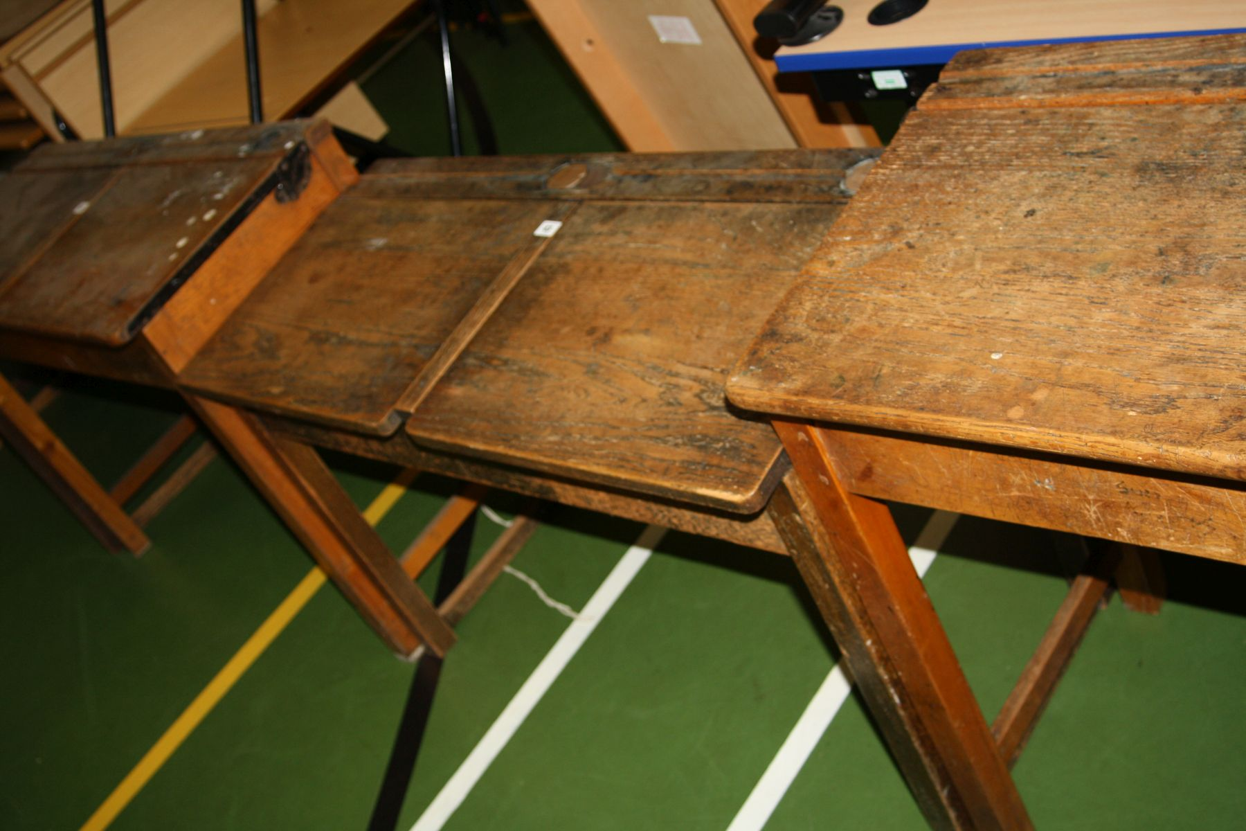 Lot 43 - A VINTAGE DOUBLE SCHOOL DESK, with oak top, two lift up lids, two copper sliding ink well cover