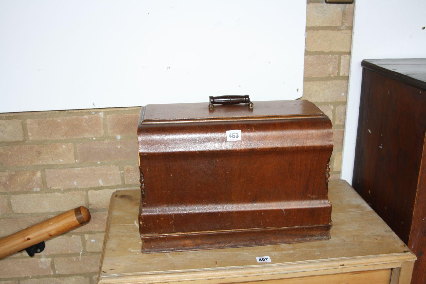 Lot 463 - A JONES WALNUT CASED MANUAL SEWING MACHINE, 43x23x33cm high