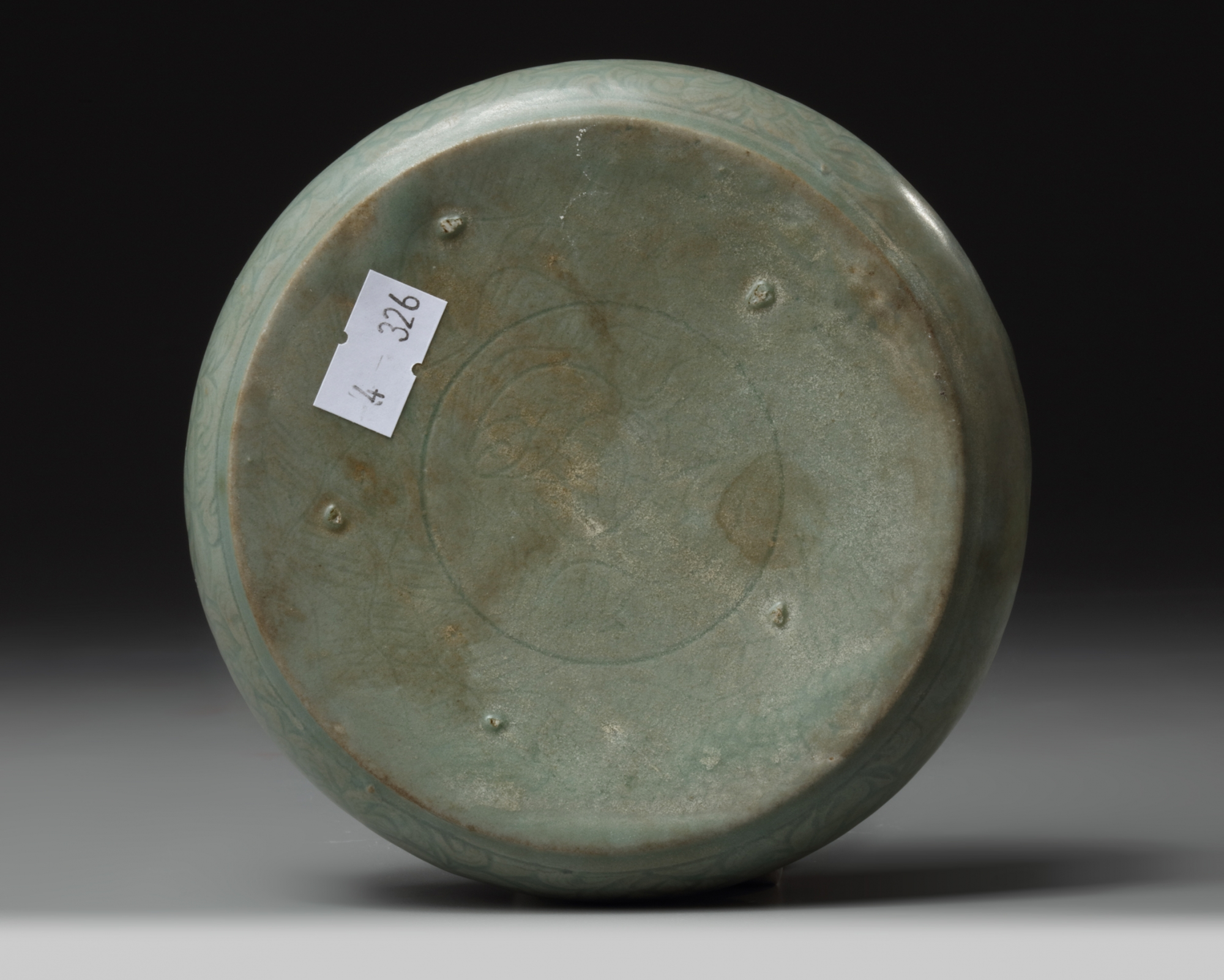 Lot 51 - A Korean celadon-glazed 'fish and waves' washer