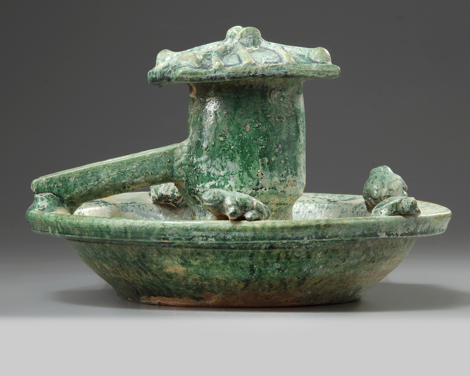Lot 4 - A Chinese green-glazed pottery frog pond
