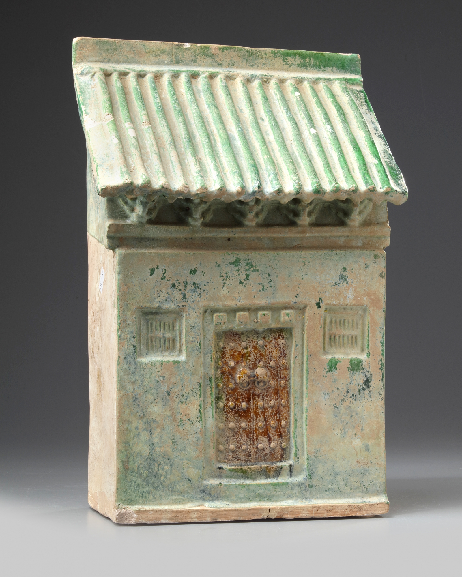 Lot 1 - A Chinese green-glazed pottery store house