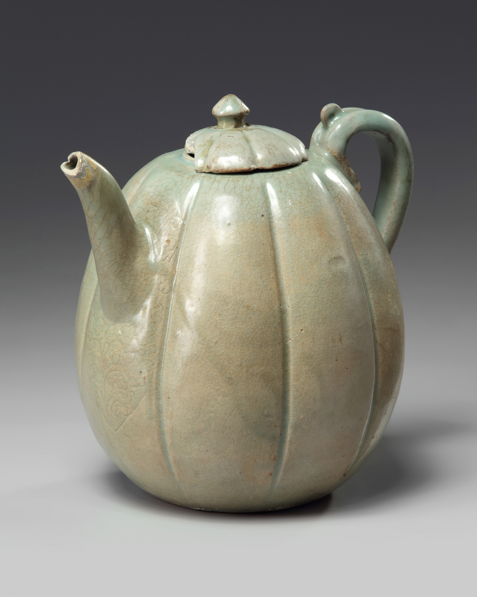 Lot 49 - A Korean celadon glazed lobed teapot and cover