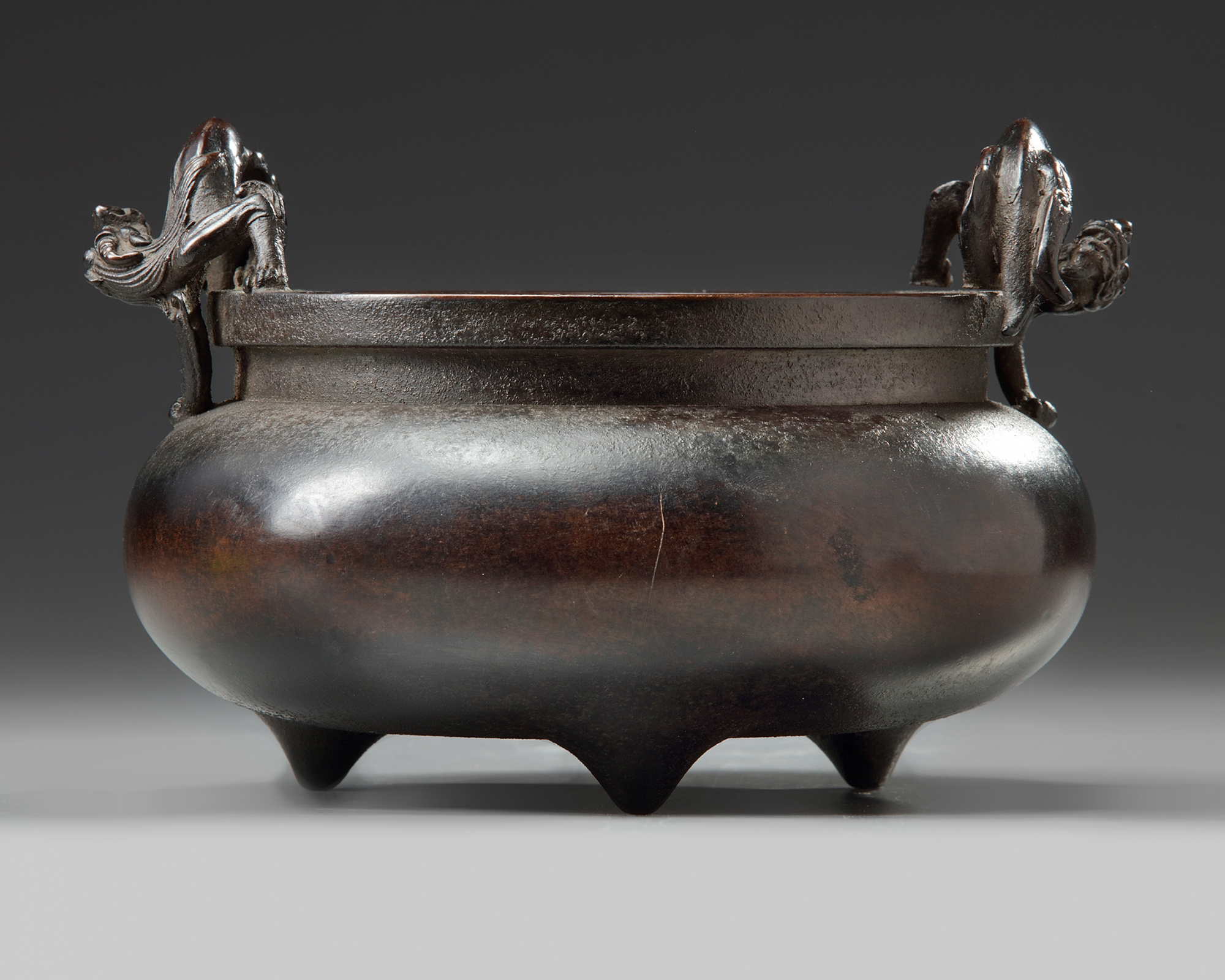 Lot 26 - A Chinese bronze 'qilin' tripod censer