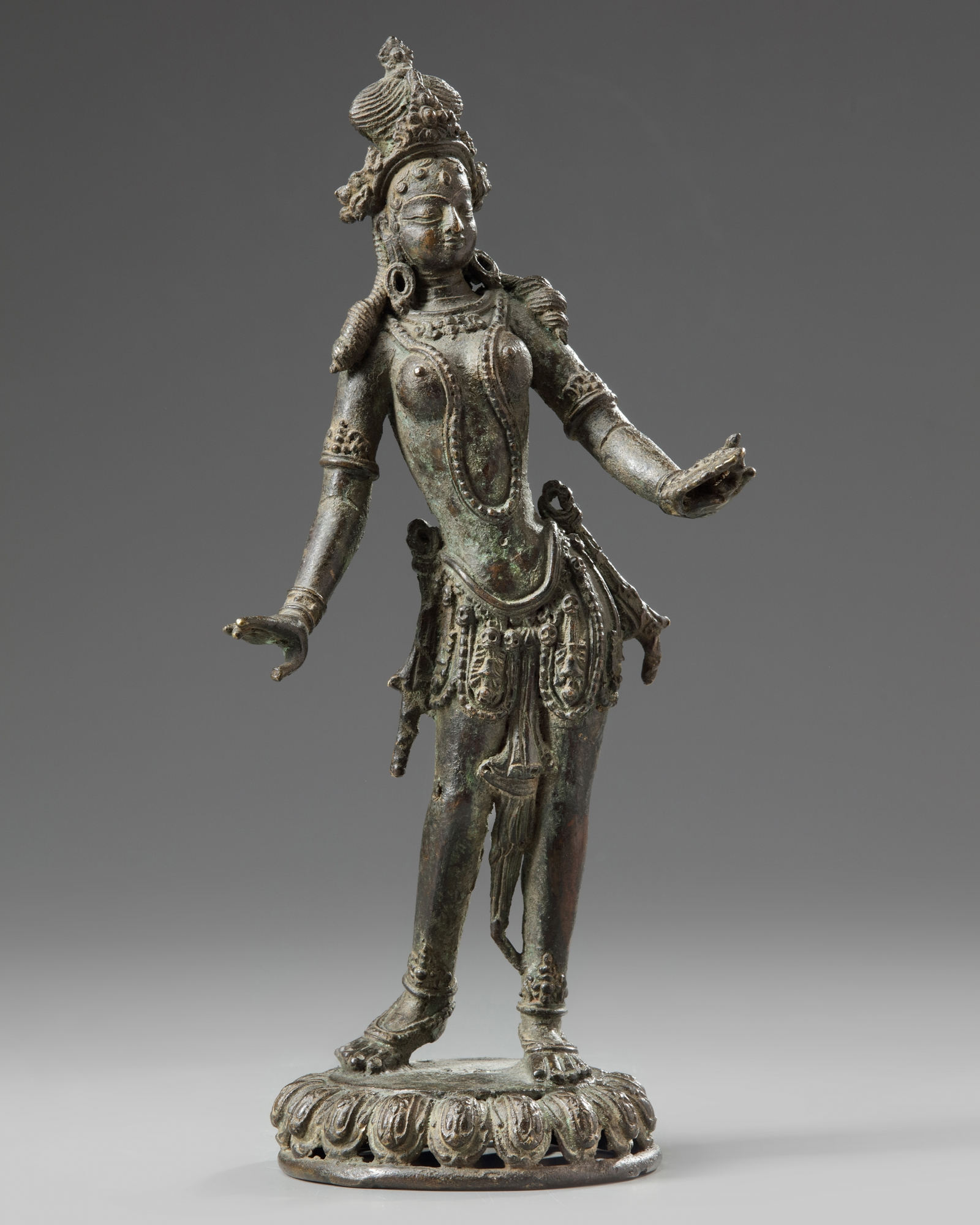 Lot 33 - A Nepalese bronze dancing Tara