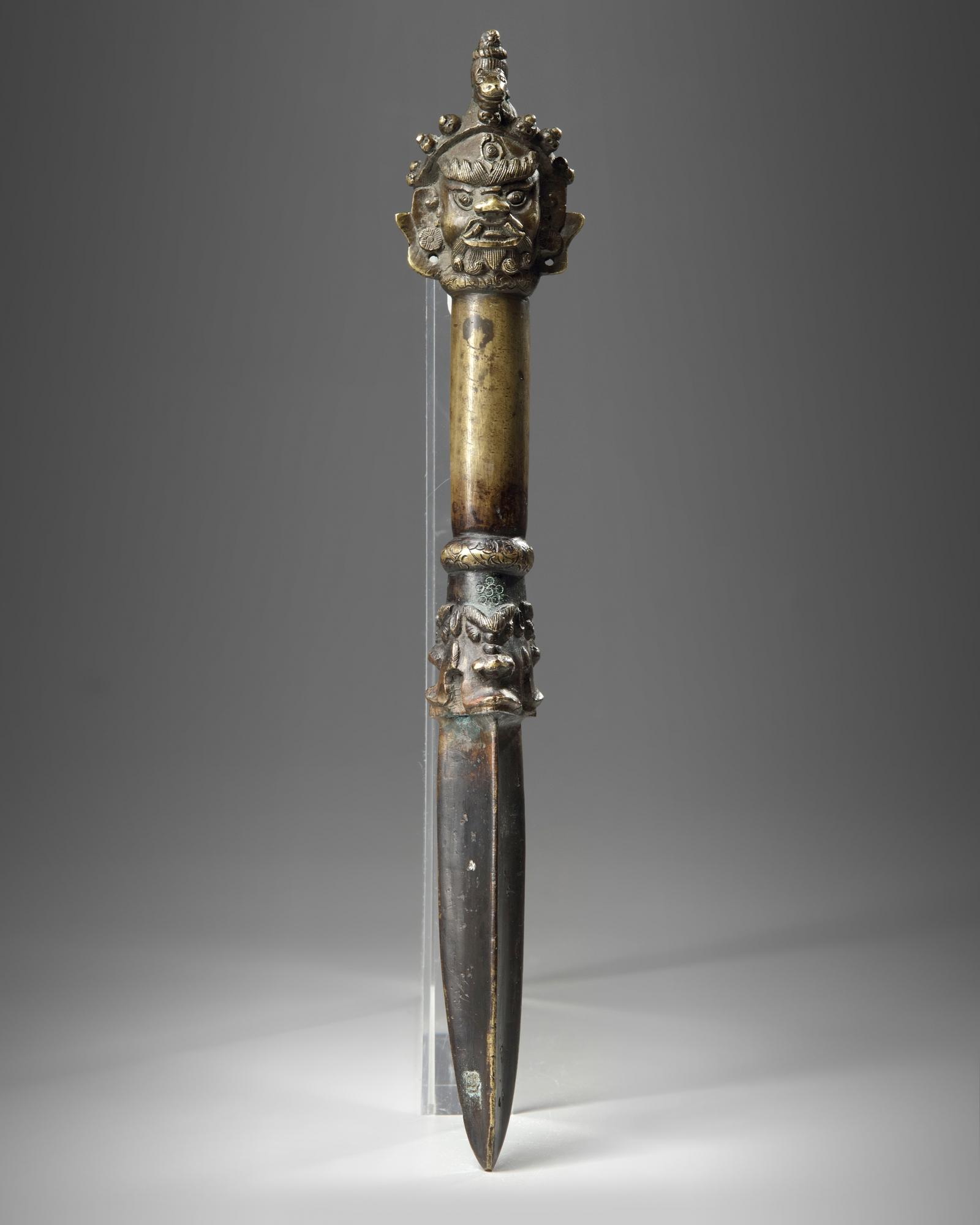 Lot 44 - A Tibetan bronze phurbu