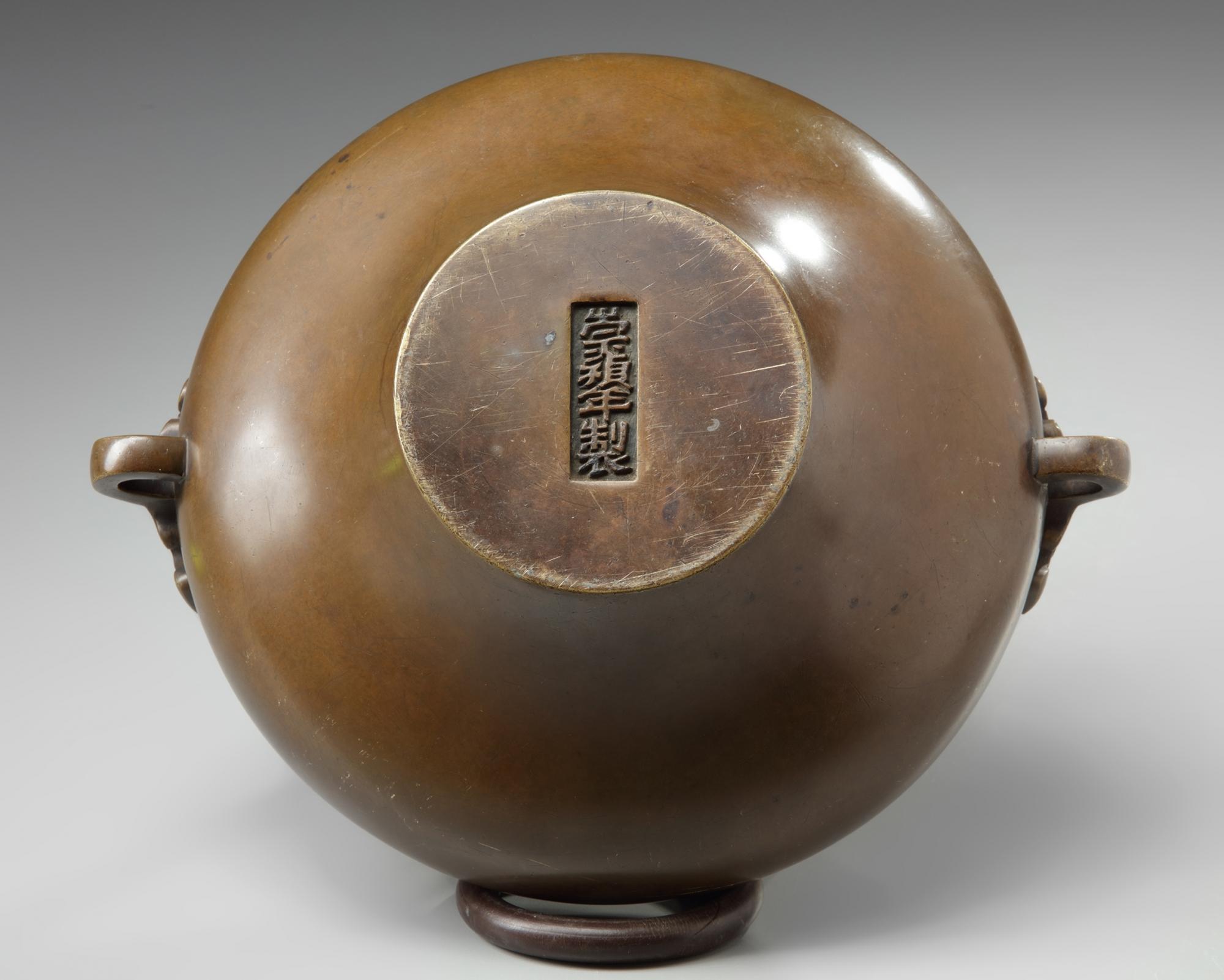Lot 42 - A Chinese bronze 'taotie' censer
