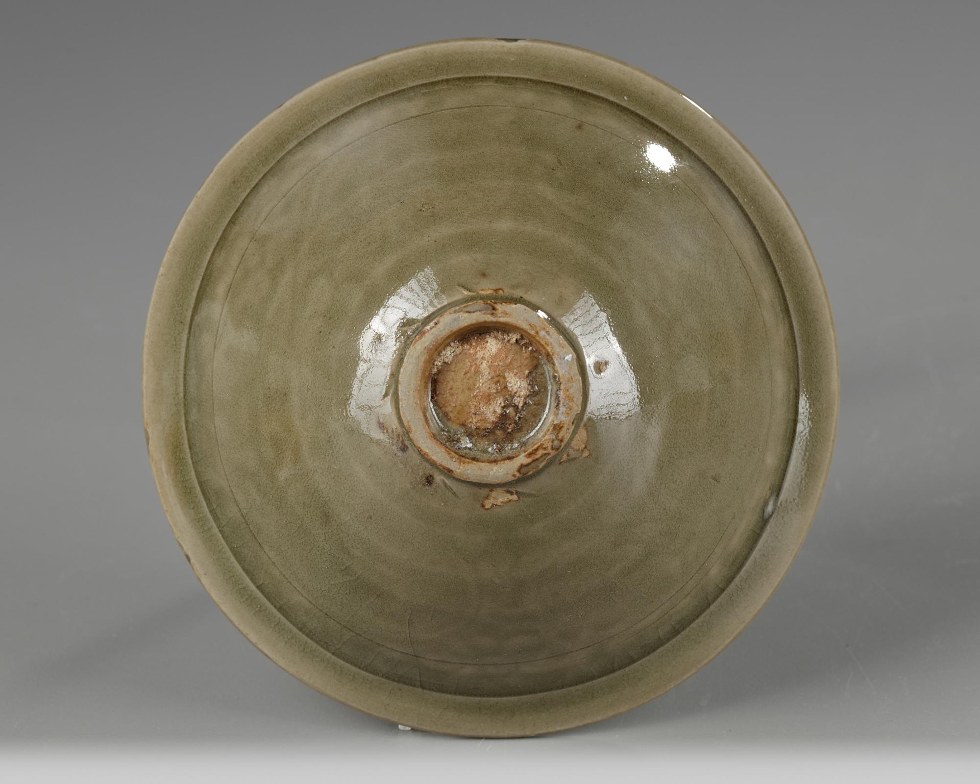 Lot 12 - A Yaozhou celadon-glazed 'chrysanthemum scroll' bowl