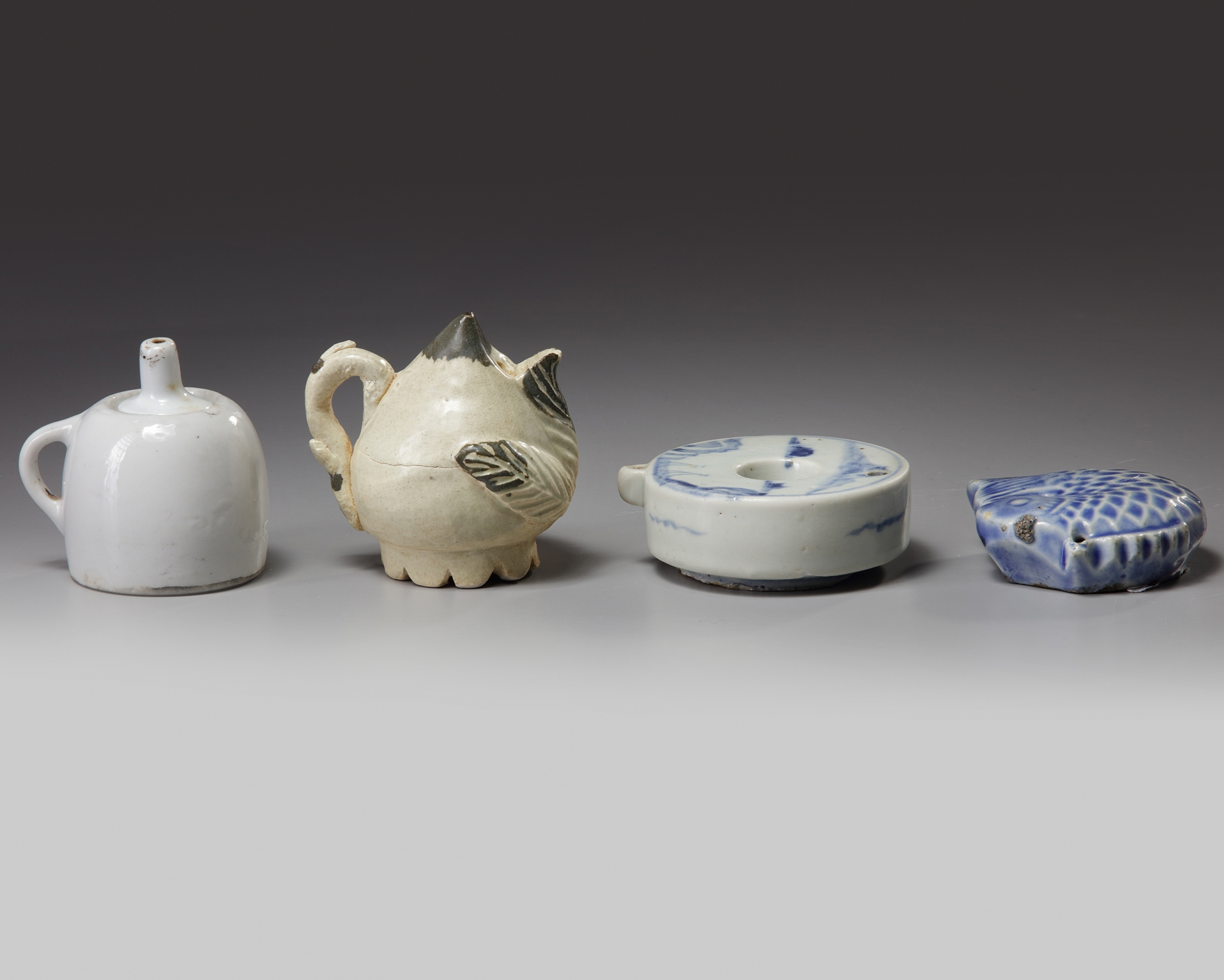 Lot 46 - Four Korean water droppers