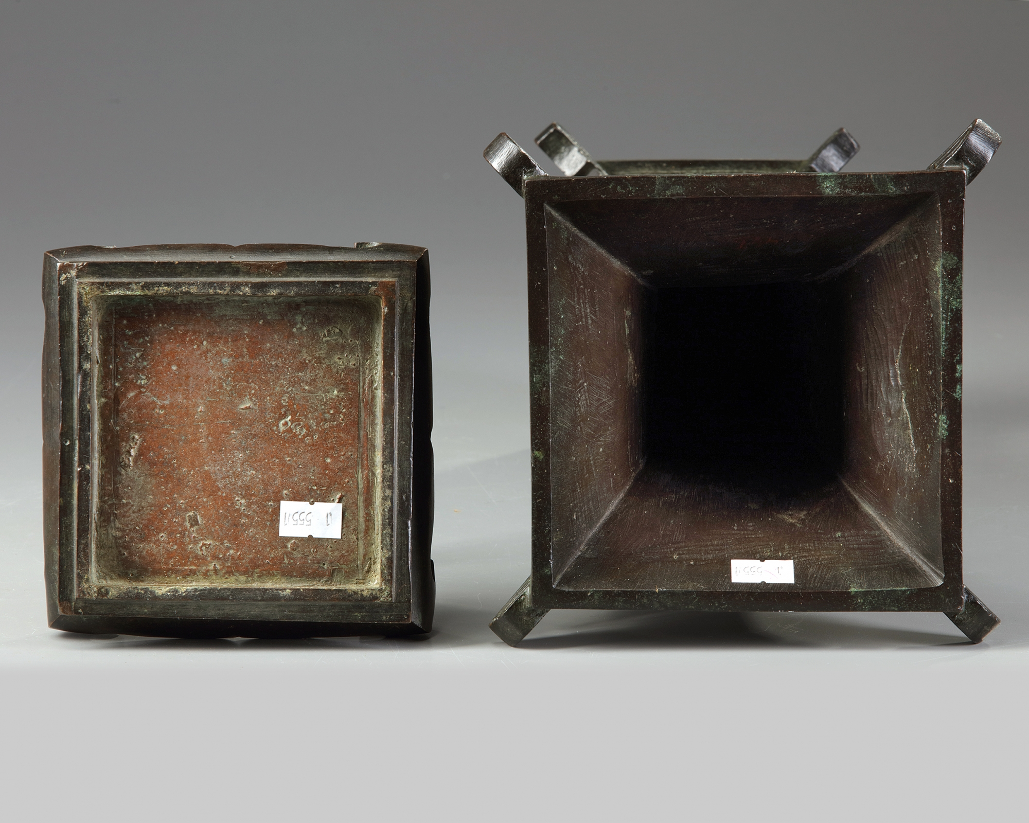 Lot 29 - A Chinese archaistic bronze square section vase, fanggu