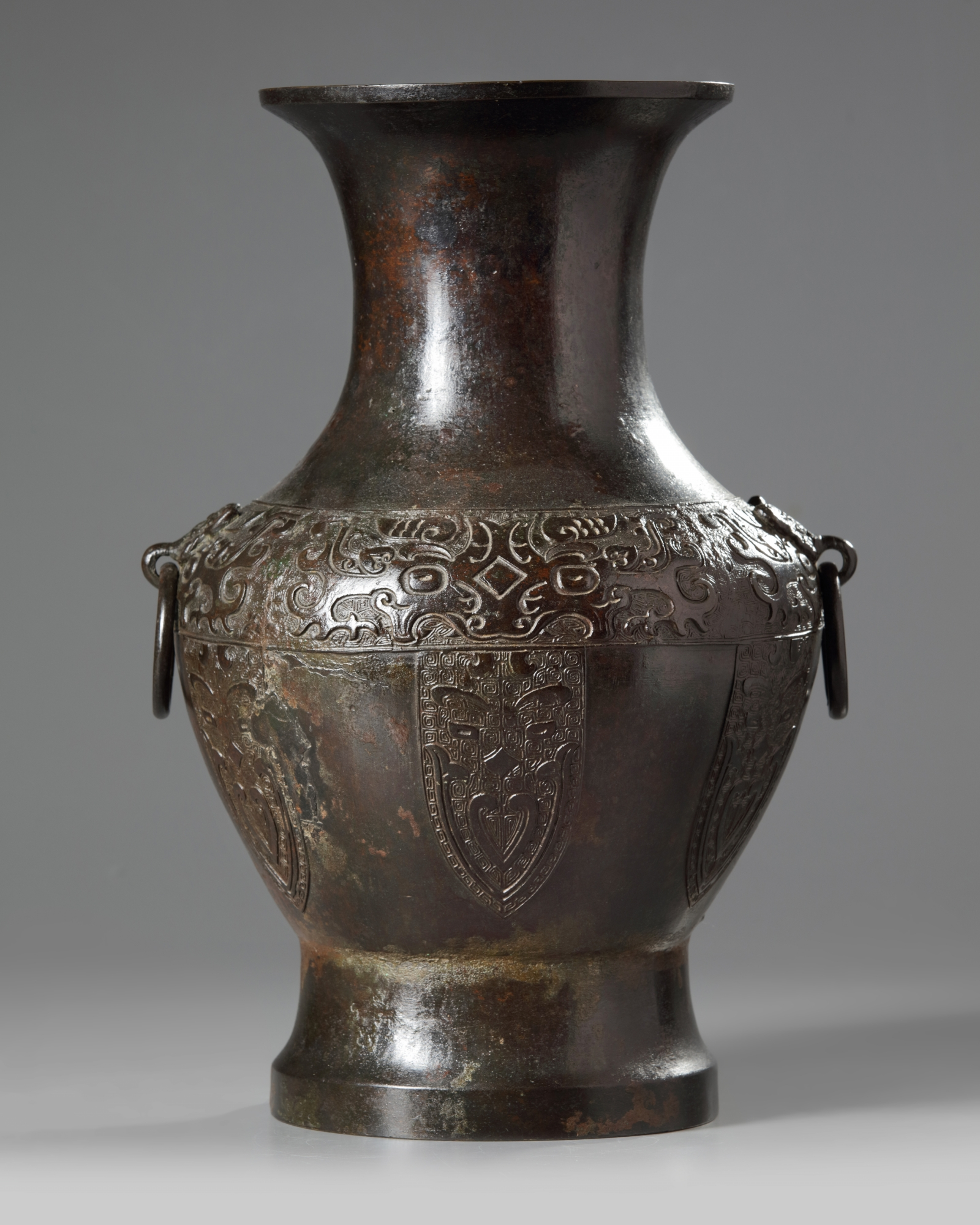 Lot 24 - A Chinese bronze archaic 'taotie' vase