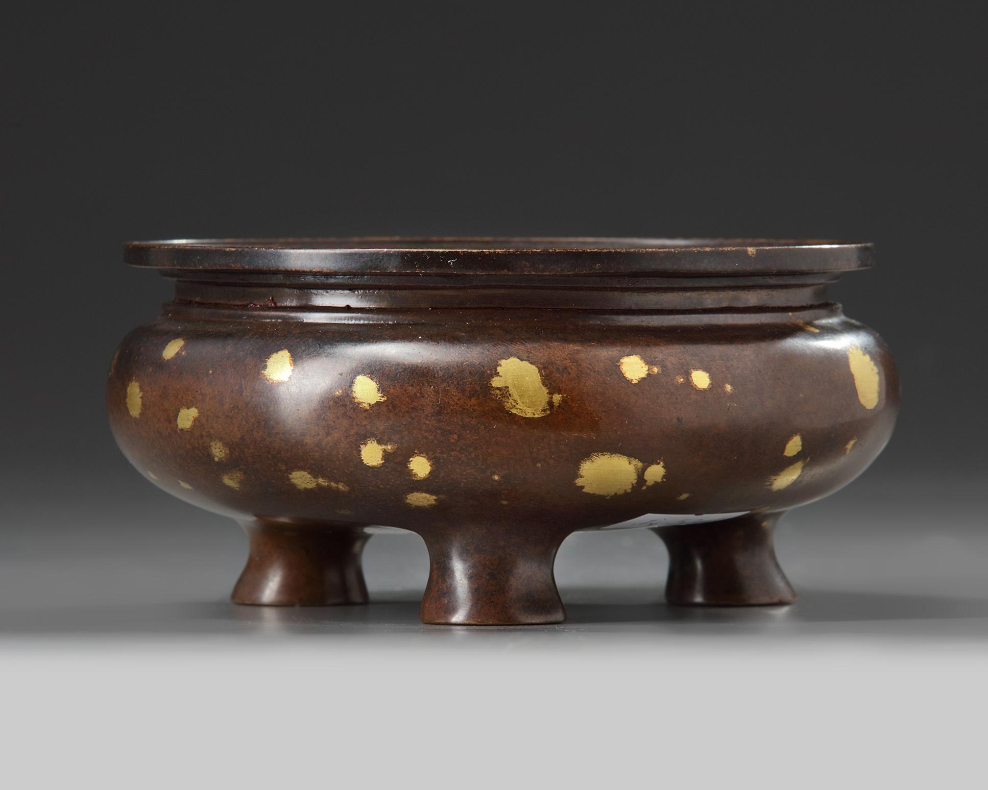 Lot 39 - A Chinese gilt splashed bronze tripod censer