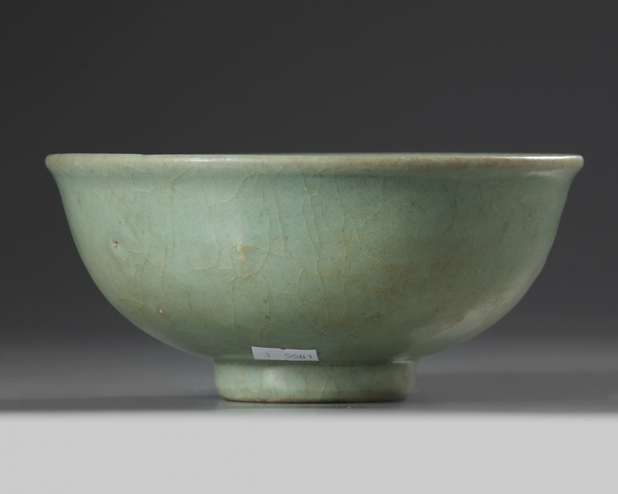Lot 54 - A Chinese Longquan celadon moulded 'floral' bowl