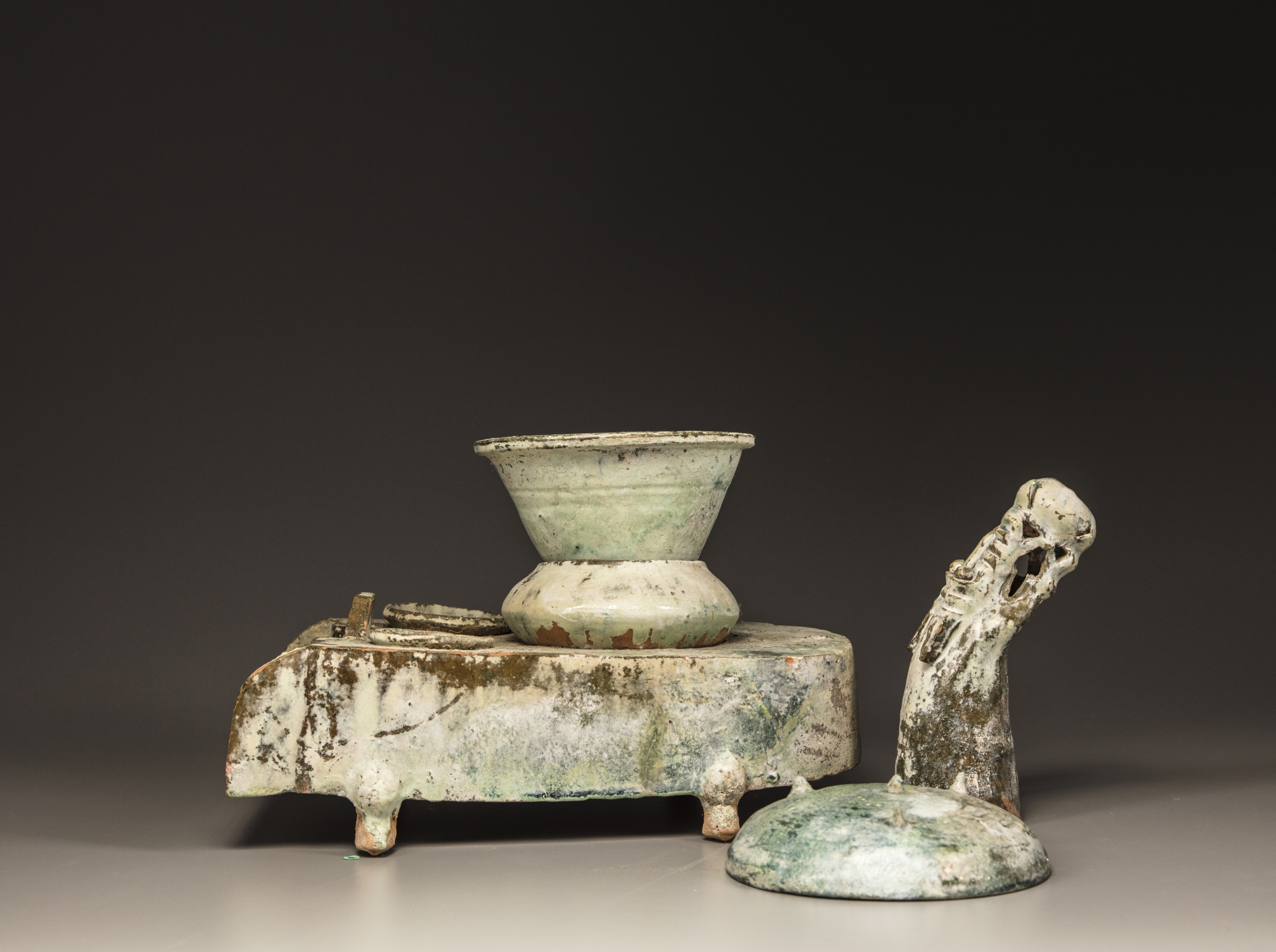 Lot 5 - A Chinese green-glazed pottery stove with a dragon chimney