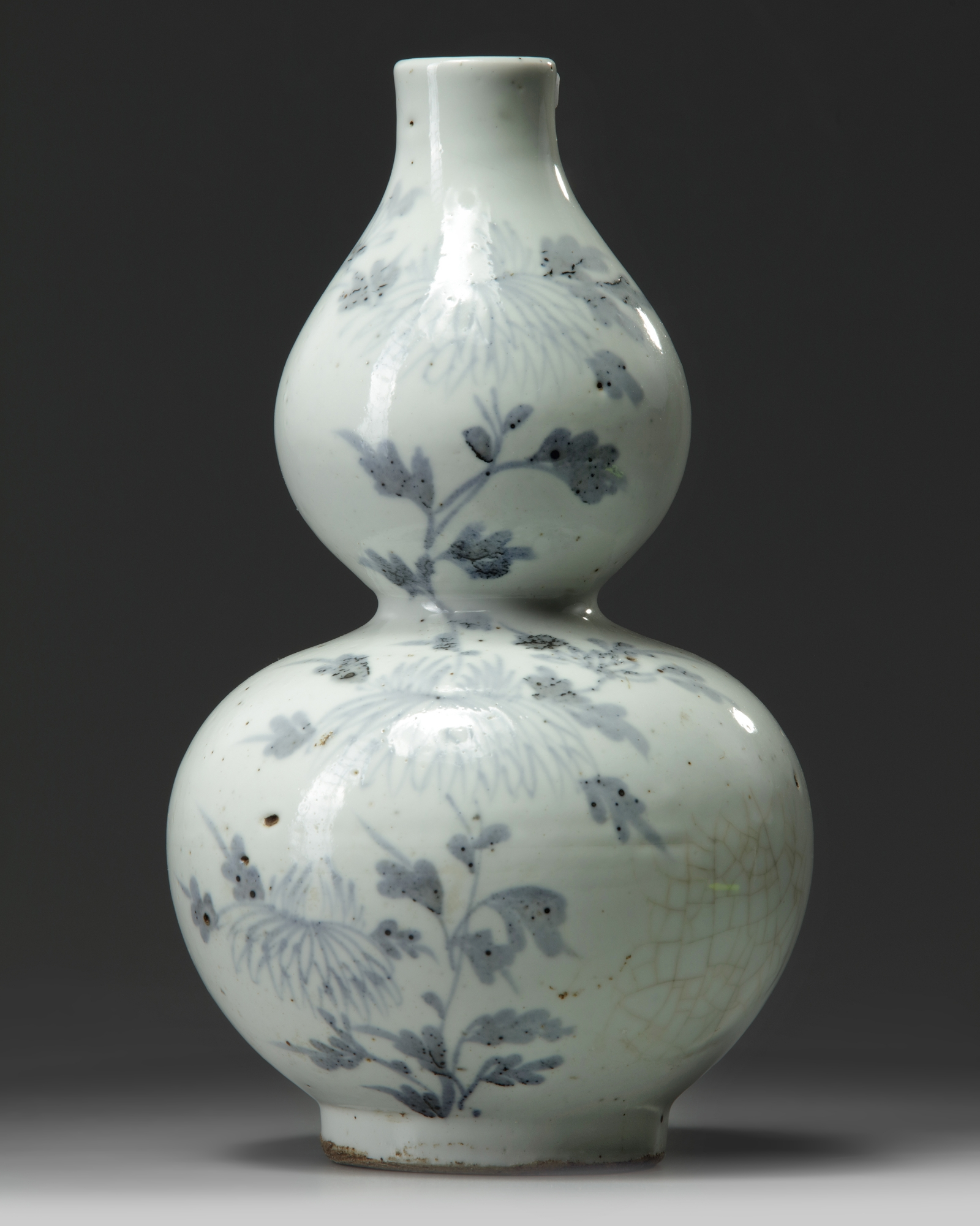 Lot 50 - A Korean blue and white 'butterfly and chrysanthemum' double gourd vase