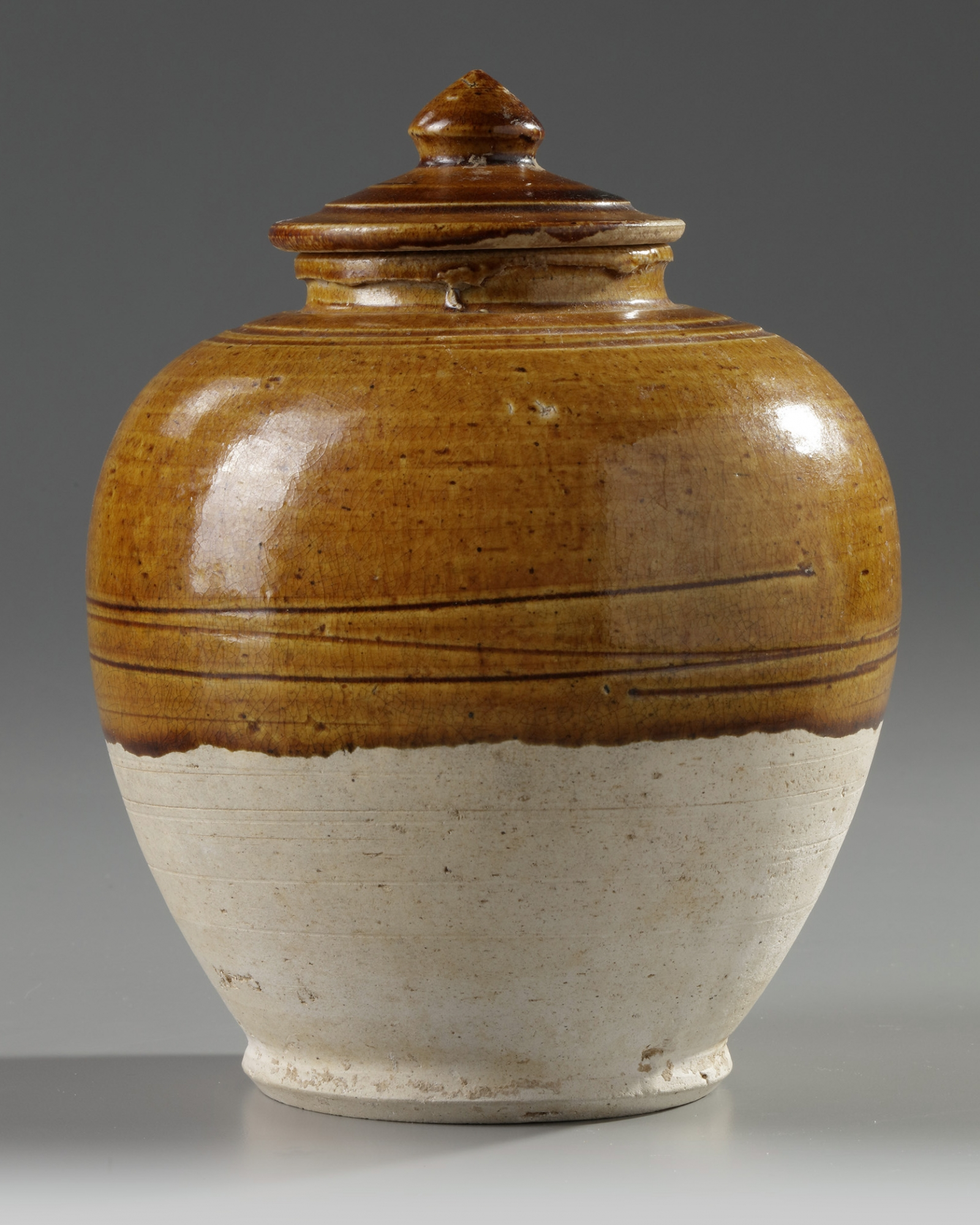 Lot 9 - A Chinese amber-glazed jar and cover