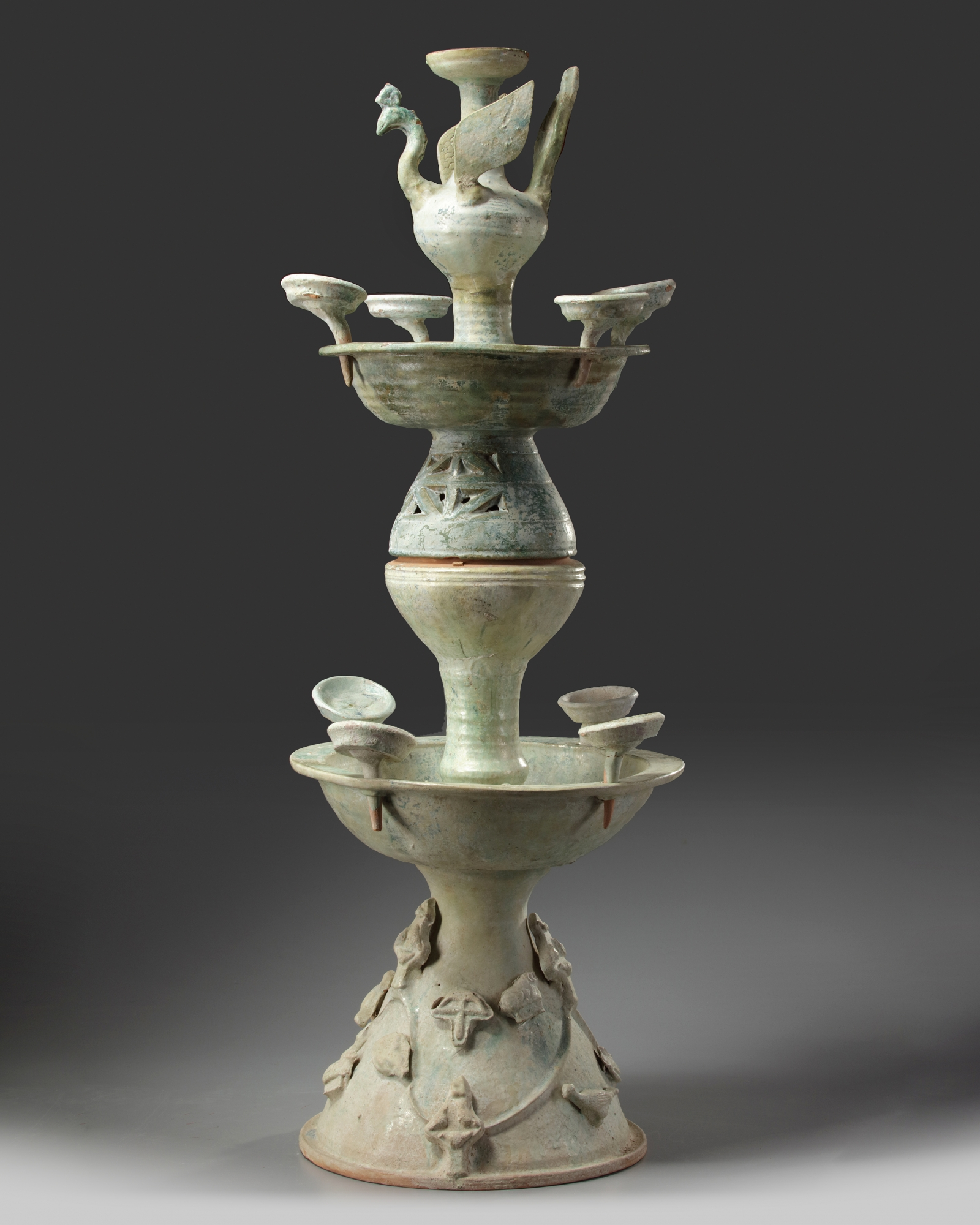 Lot 6 - A Chinese green-glazed pottery two-tiered oil lamp