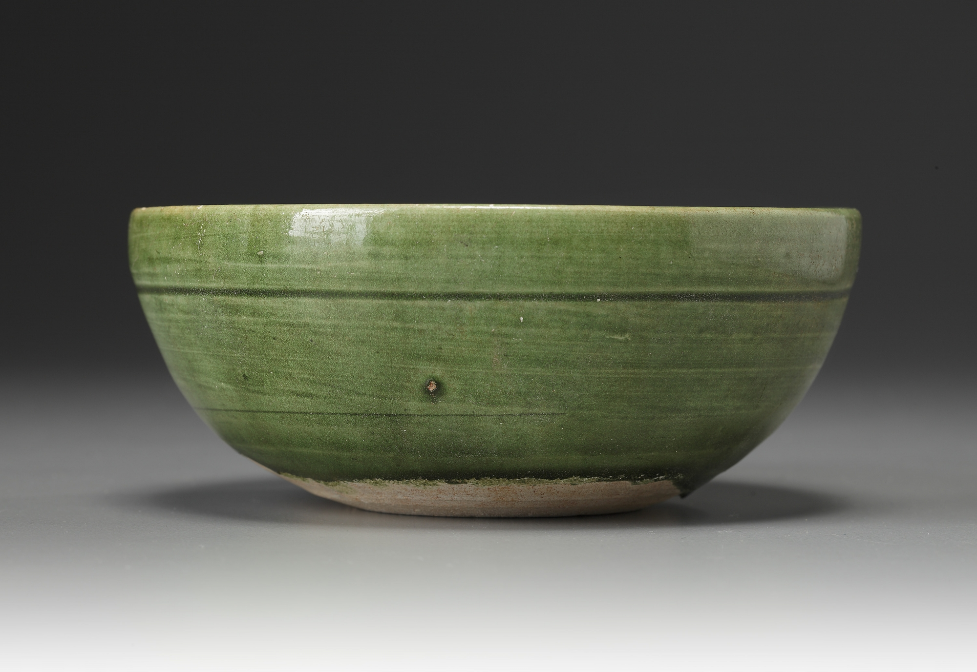 Lot 11 - A Chinese green lead-glazed bowl