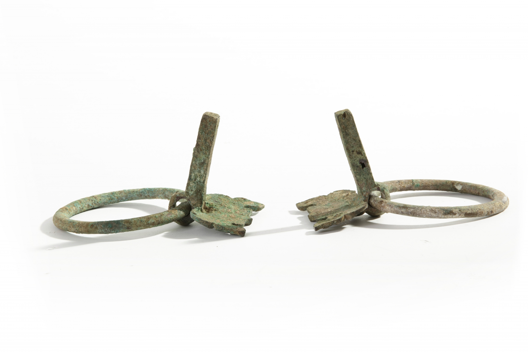 Lot 17 - A pair of Chinese bronze taotie mask fittings with loose-ring handles