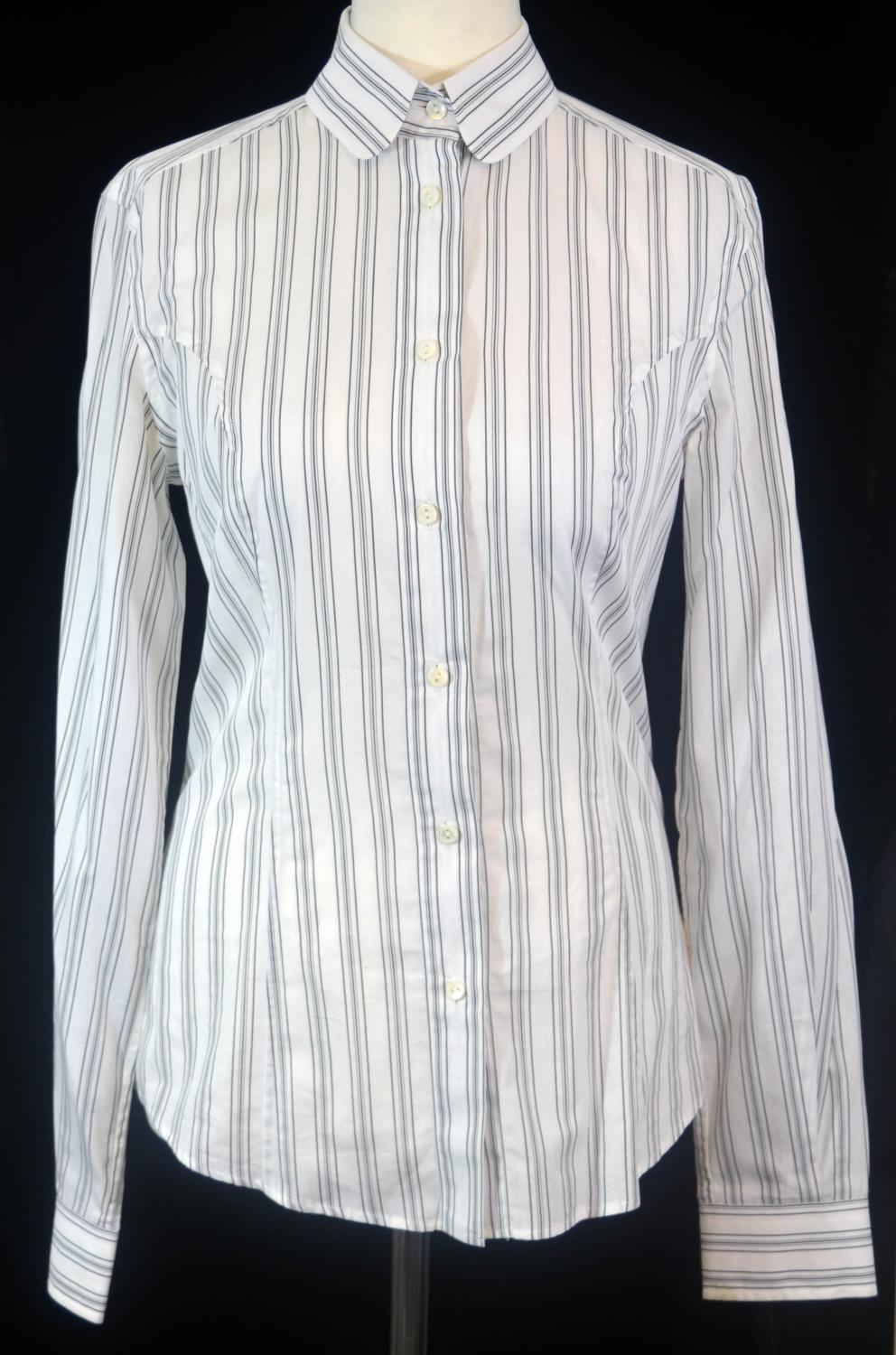 Lot 275 - DOLCE & GABBANA, WHITE COTTON SHIRT With black stripes and tailored waist (size 44). A