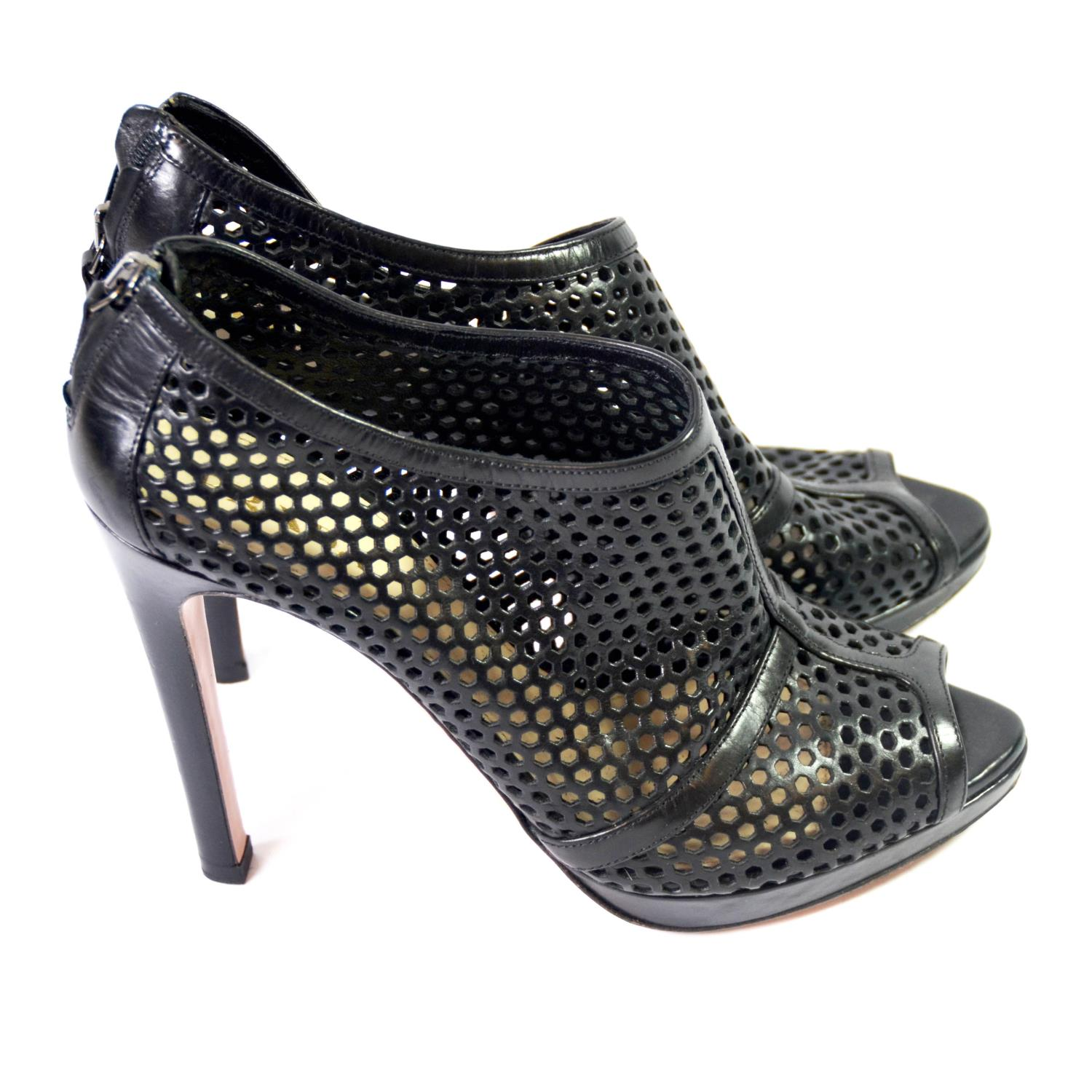 Lot 14A - PRADA, BLACK LEATHER HEELS With honeycomb cut out pattern, back zip, open toe (size 38½). (heel 11.