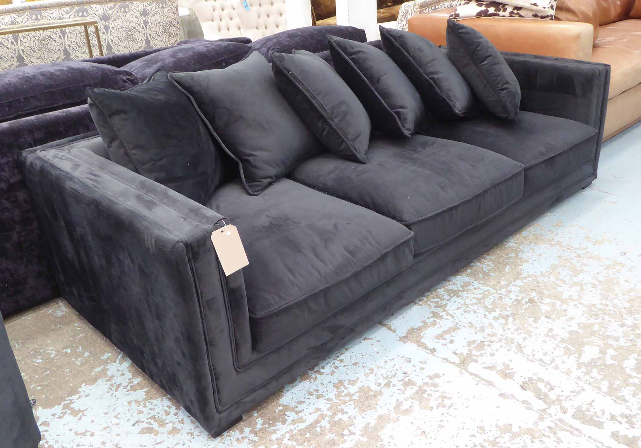 Lot 49 - EICHOLTZ SOFA, in black upholstery with six black scatter cushions, 240cm x 103cm x 64cm H.