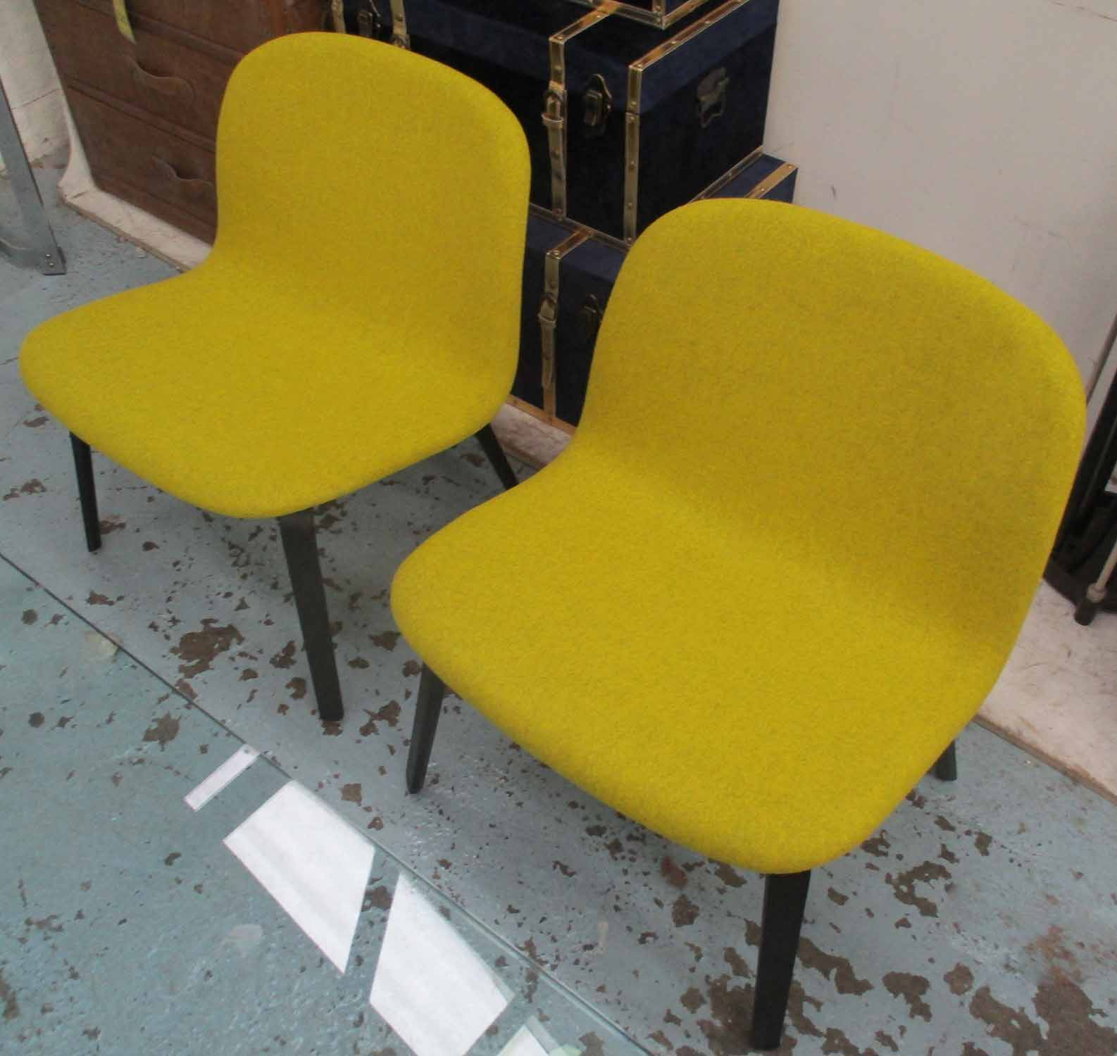 Lot 11 - MUUTO LOUNGE CHAIRS, a pair, in mustard upholstery on ebonised supports, designed by Mika Tolvanen,