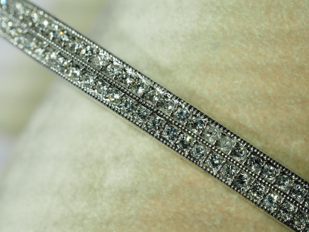 Lot 49 - High Fashion Crystal Bangle in Two Rows. Retail $89