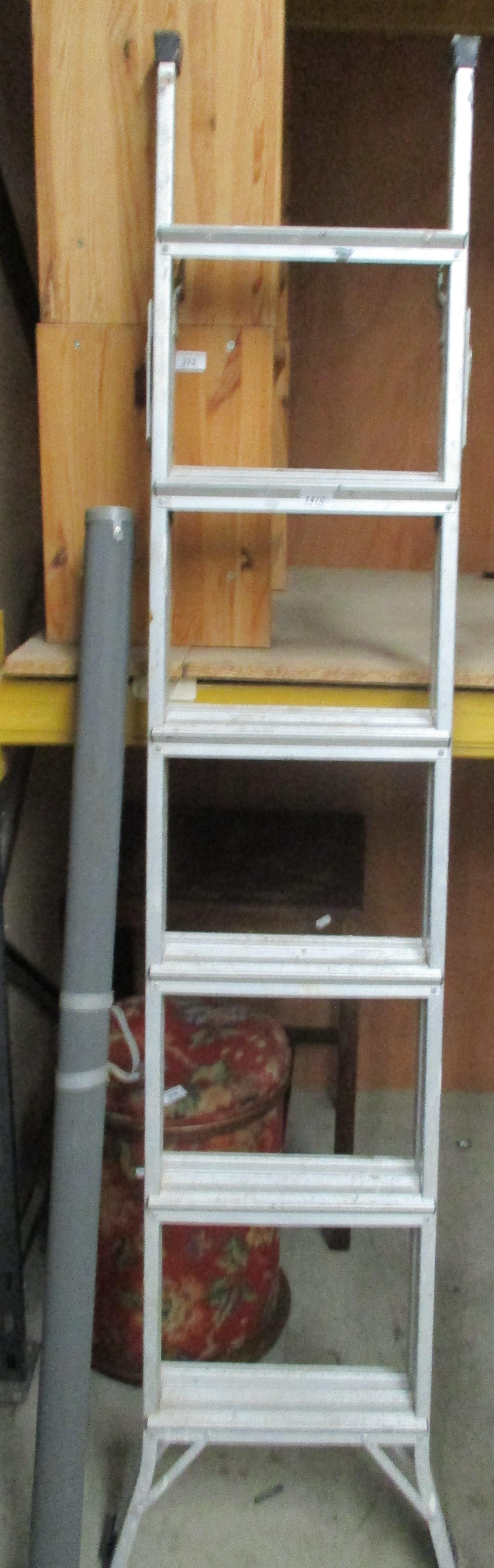 Lot 1470 - An aluminium 3 way ladder and Boots Simplex projector screen in case (2)