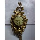 A Dutch gilt wood Cartel style wall clock, the round convex dial with Roman and Arabic numerals, the