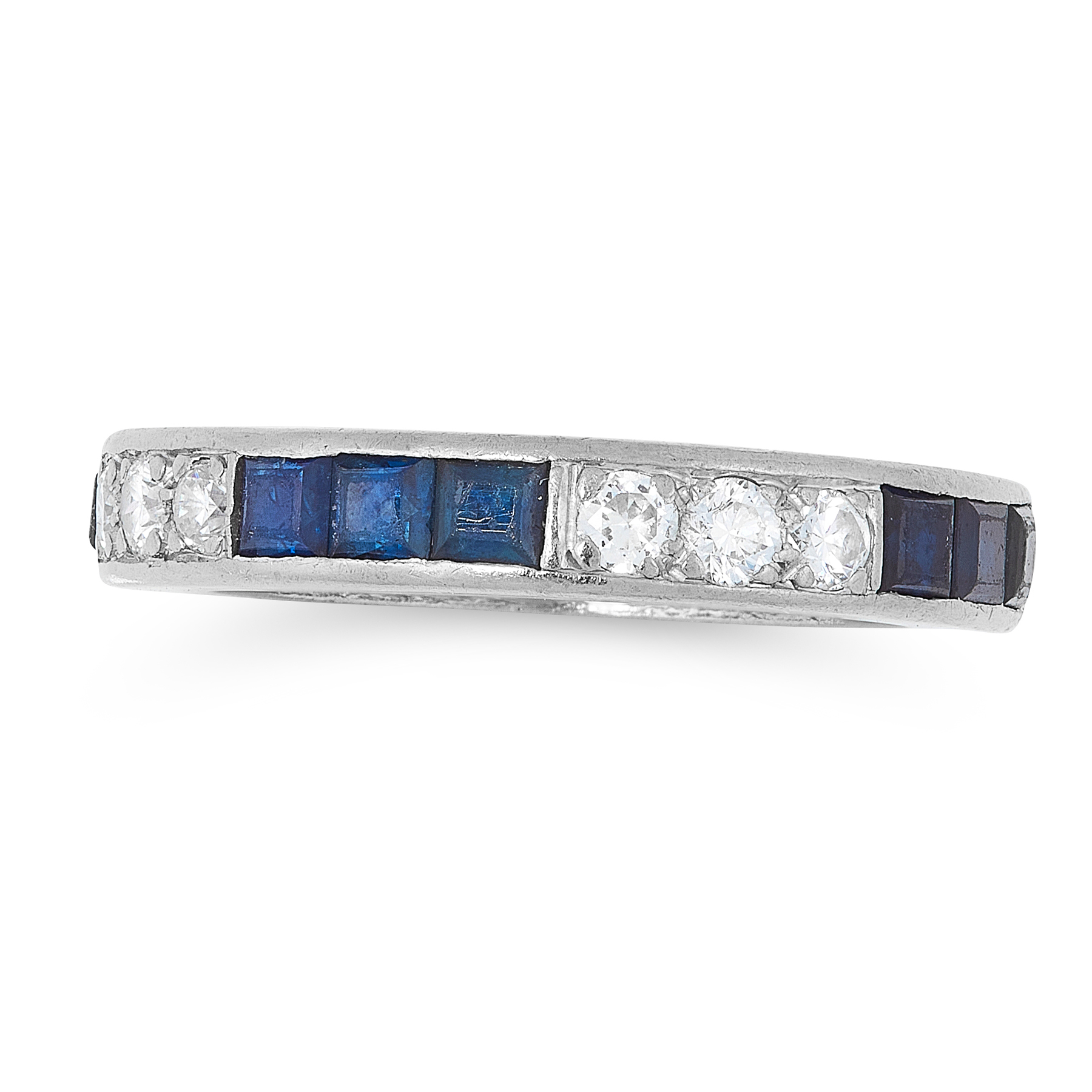 A SAPPHIRE AND DIAMOND ETERNITY RING CIRCA 1940 in platinum, designed as a band of alternating trios