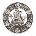 A VINTAGE SCOTTISH SAILING SHIP BROOCH, 1953 in sterling silver, of circular form, depicting a