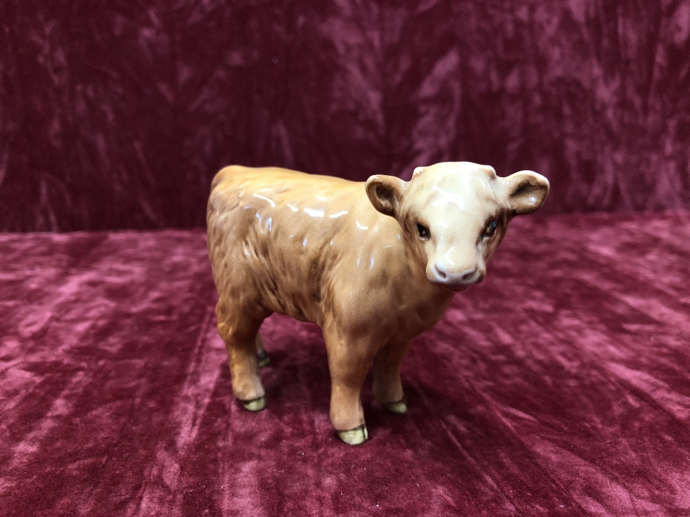 Lot 6 - A Beswick Highland bull, cow and calf.