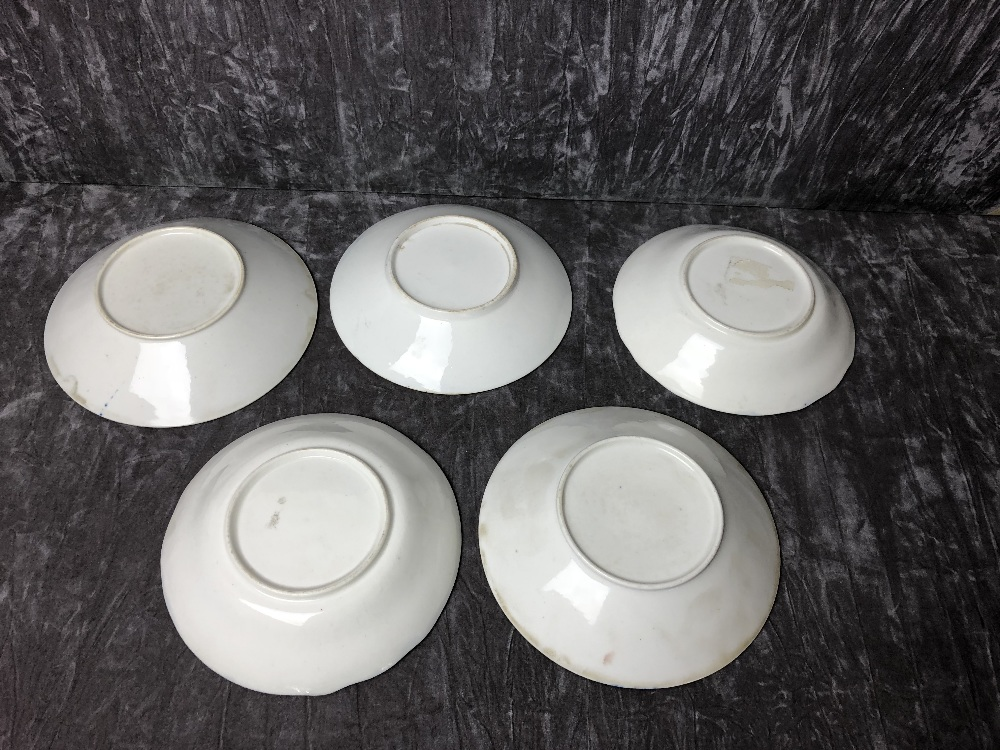 Lot 40 - Five late 18th Century/early 19th Century assorted saucers.