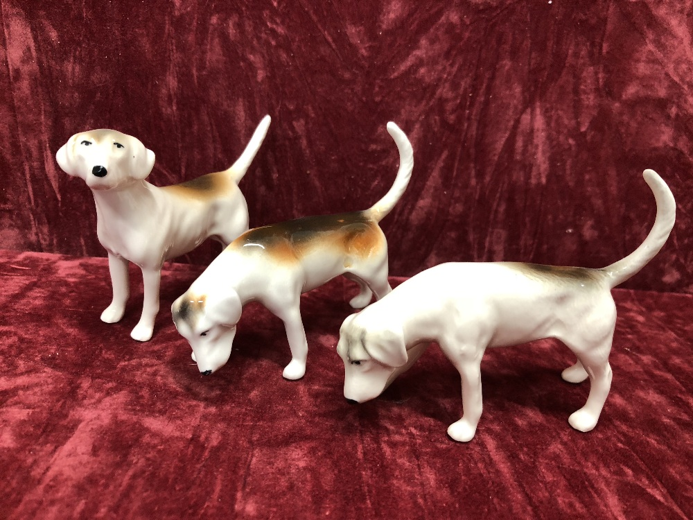 Lot 11 - A Beswick hunting scenes to include seven fox hounds, two foxes, one huntsman and one huntswoman.