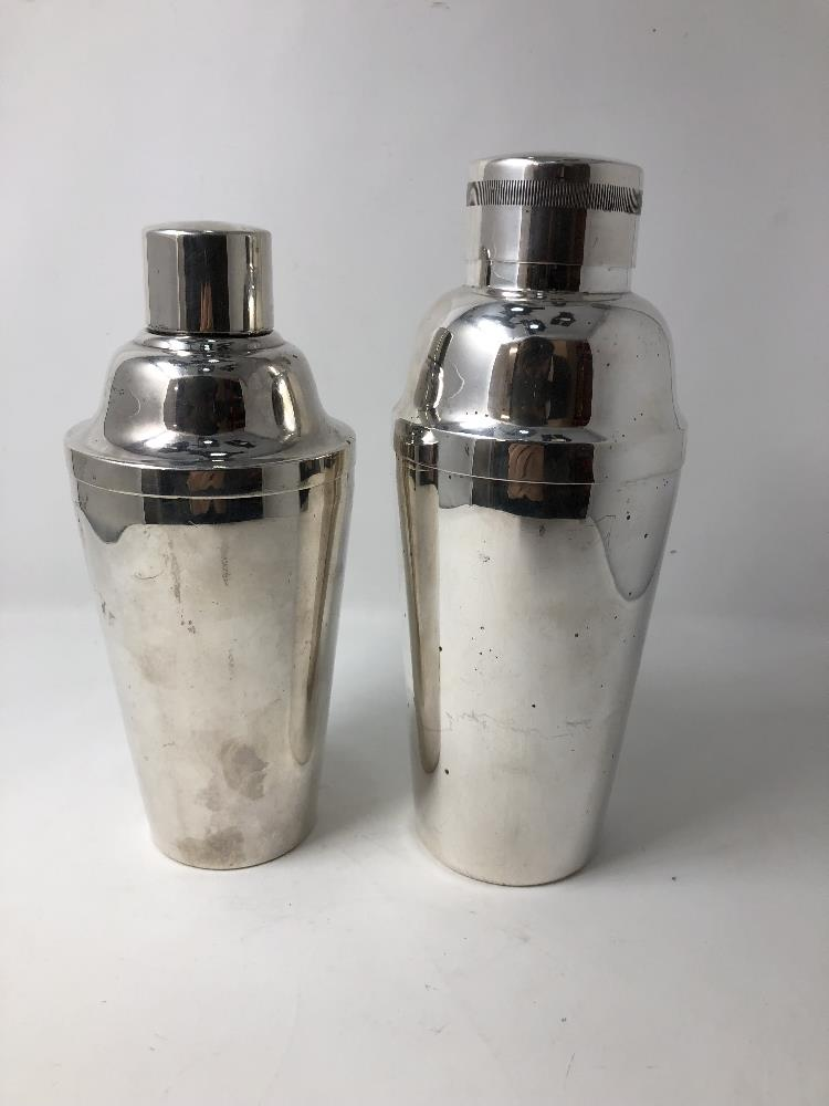 Lot 33 - Two silver plated cocktail shakers.