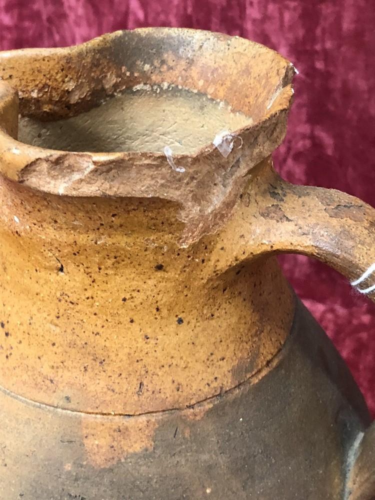 Lot 49 - A 19th Century terracotta milk/cream jug.