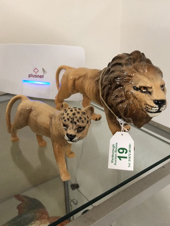 Lot 19 - A Beswick lion and lioness.