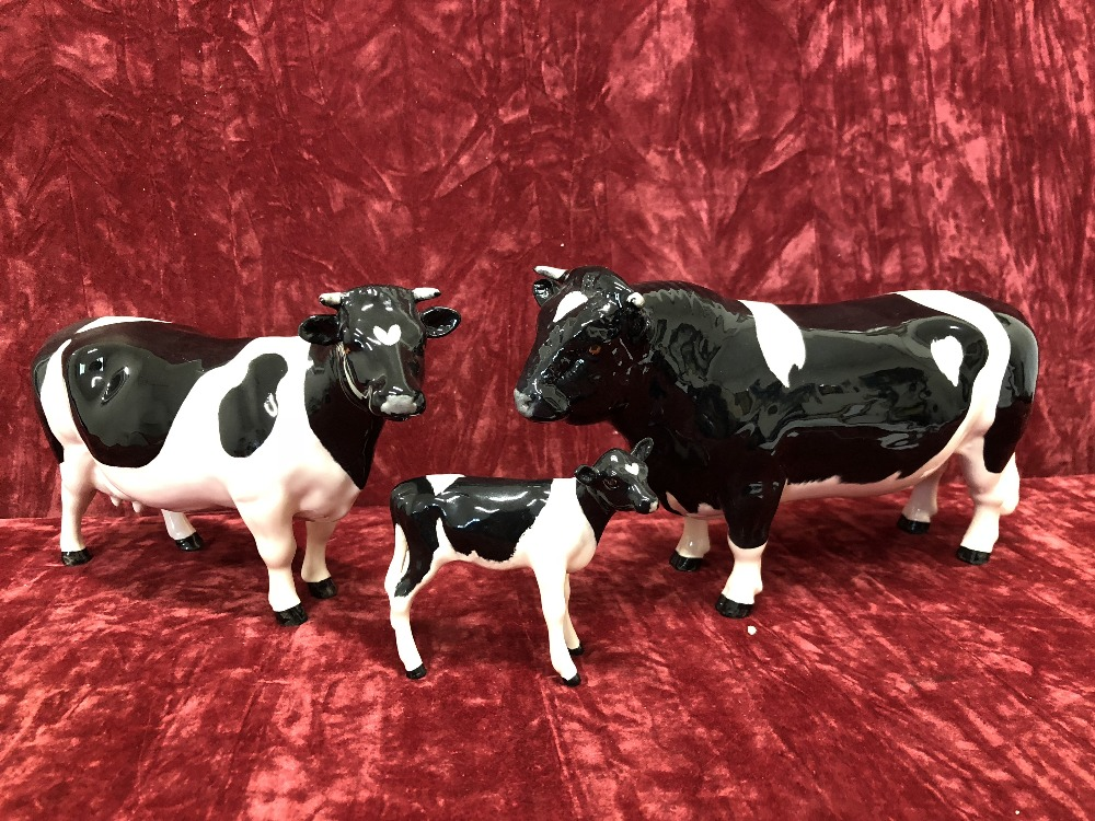 Lot 7 - A Beswick Friesian bull, cow and calf.
