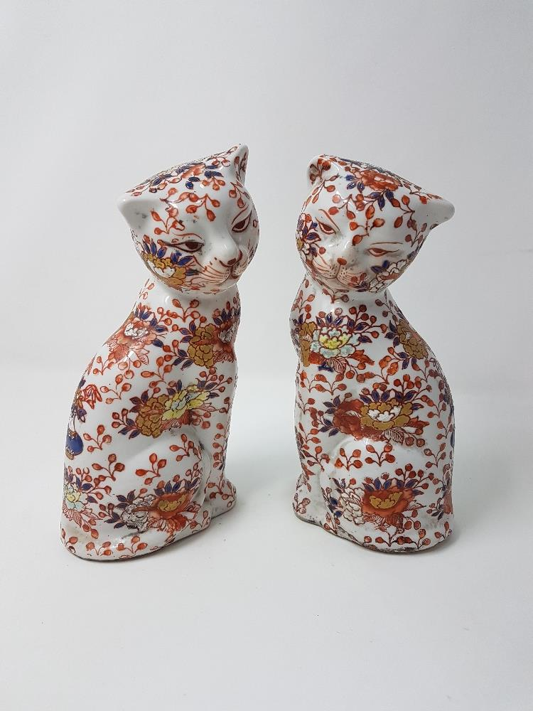 Lot 30 - A near pair of Oriental seated cats.