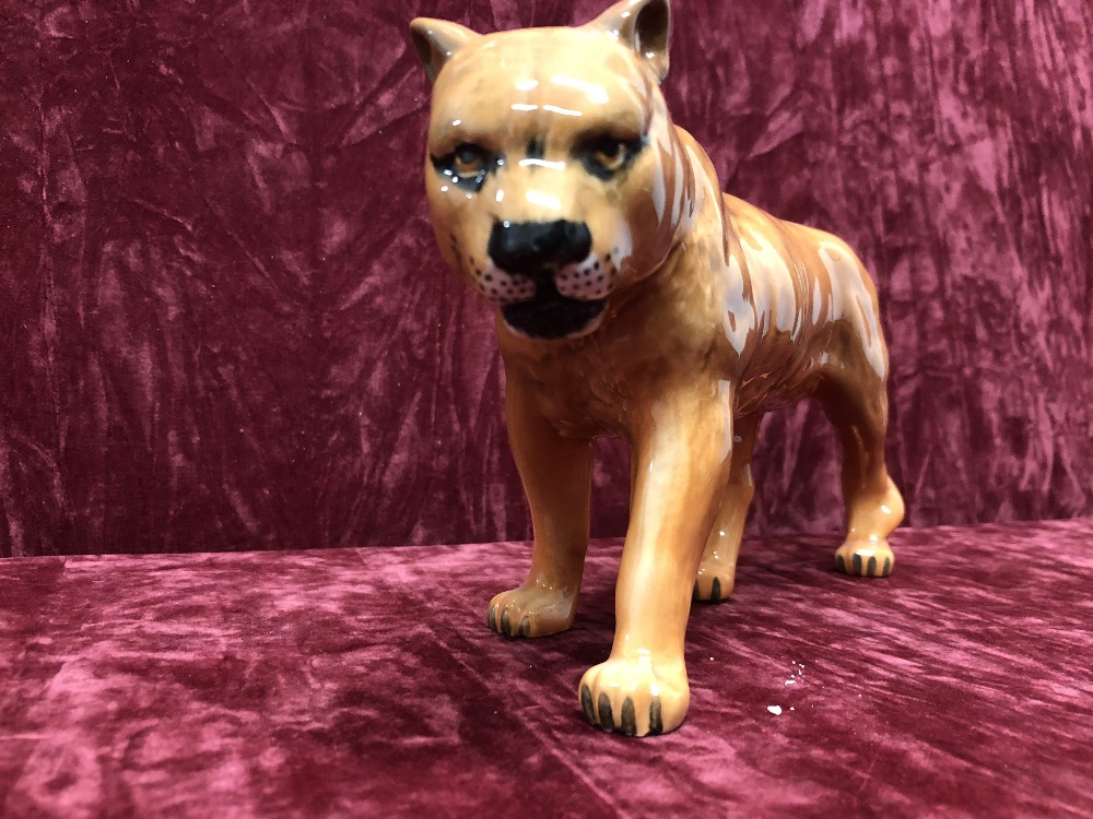 Lot 9 - A Beswick lion and lion cub, and two lionesses (2098 and 1507).